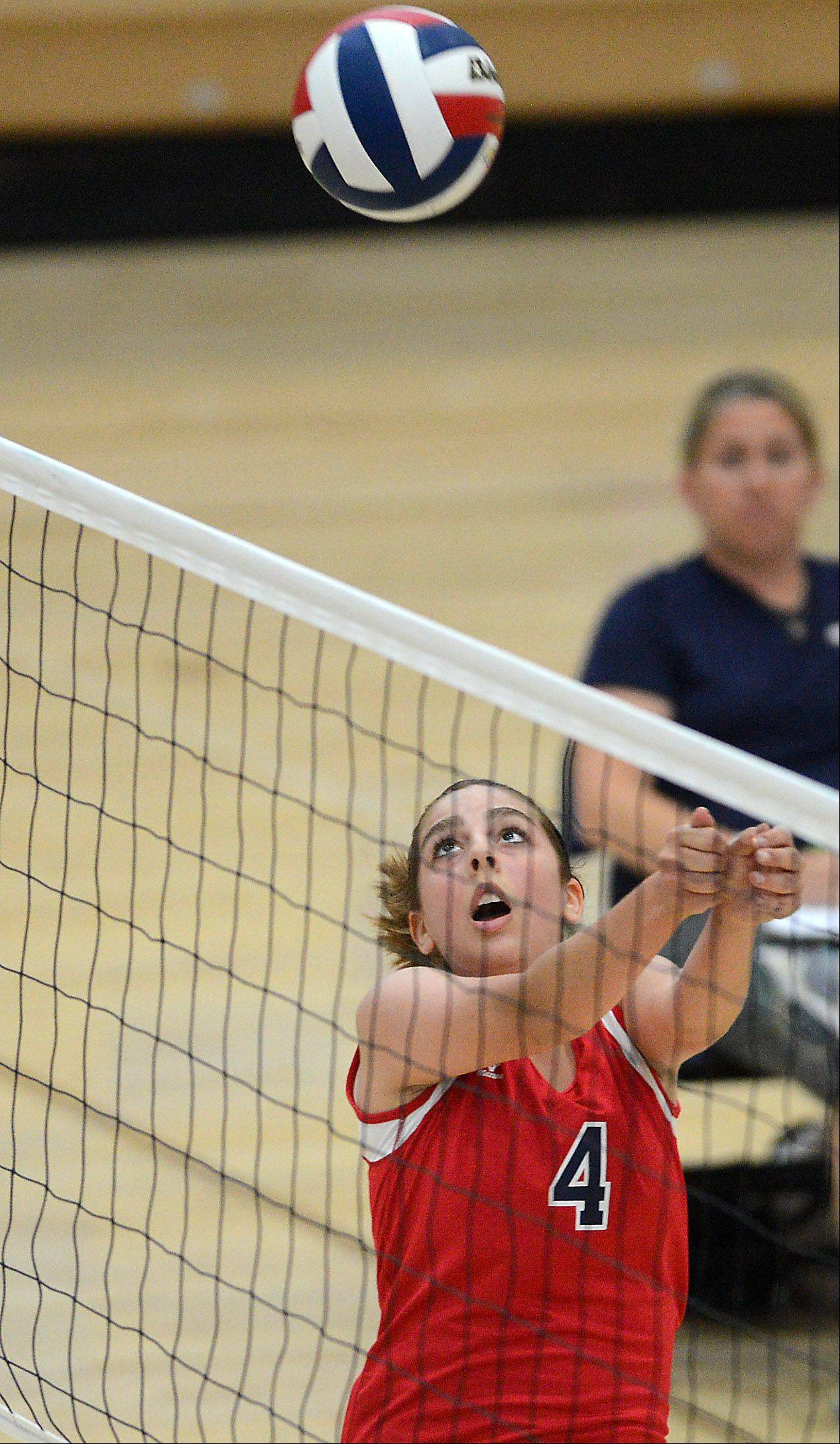 South Elgin's Adrianna Loiacono bumps the ball during Thursday's volleyball match against St. Charles North.