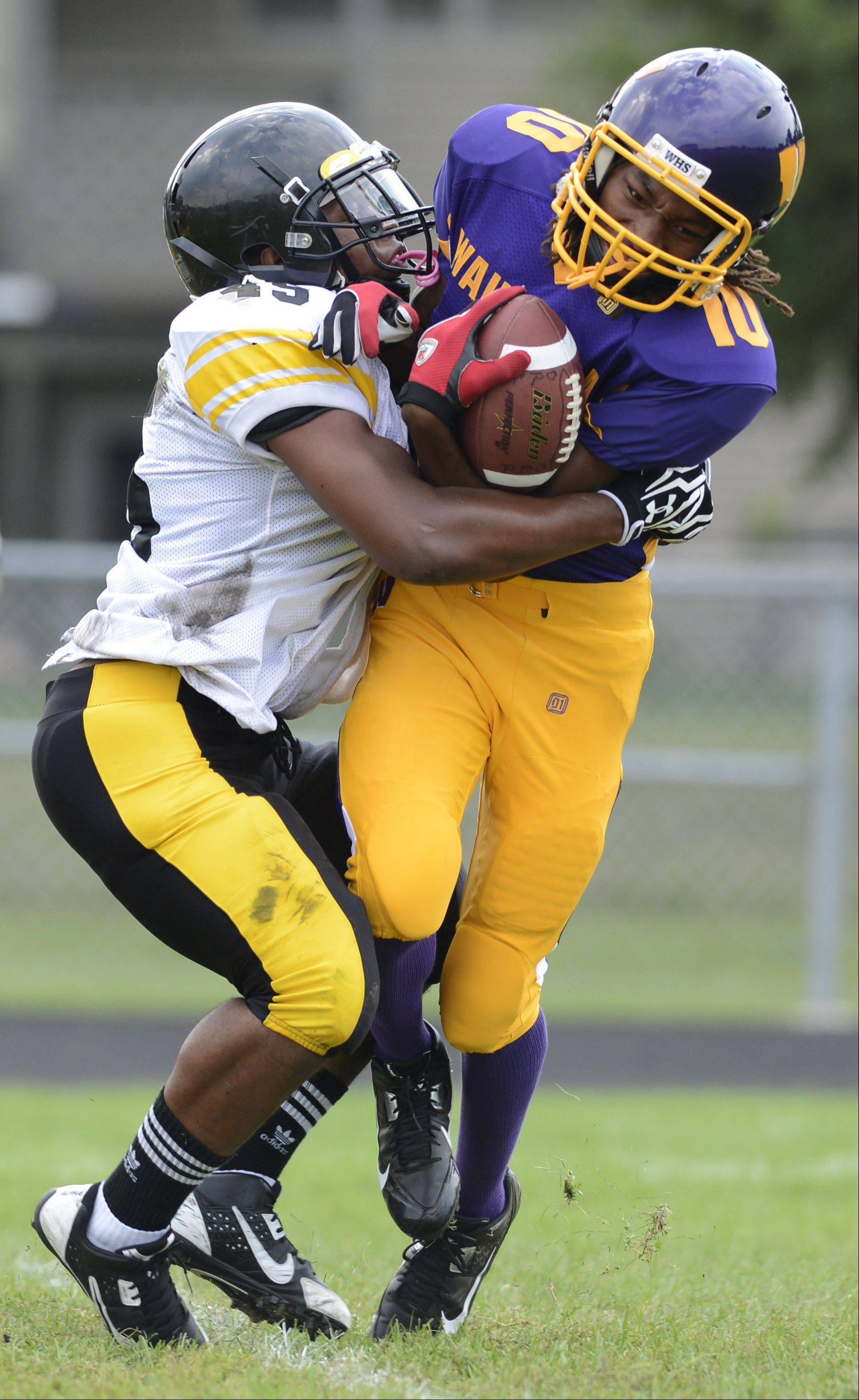 Wauconda's Imsa Bowman, right, is tackled by Chicago Orr's Daniel Sanja during Saturday's football game in Wauconda.