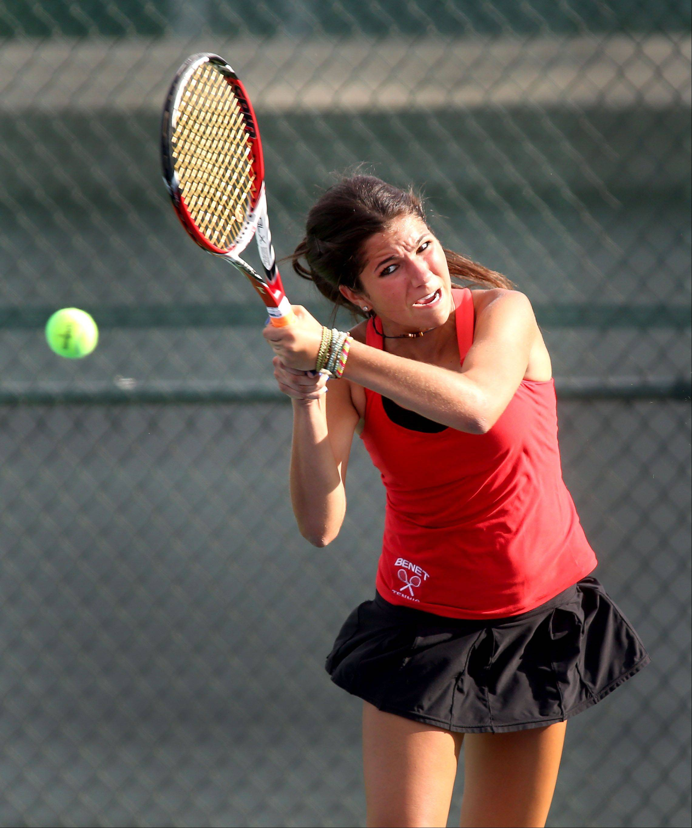 Benet's Leah Tzakis returns the ball during Tuesday's tennis match against Naperville Central in Naperville.
