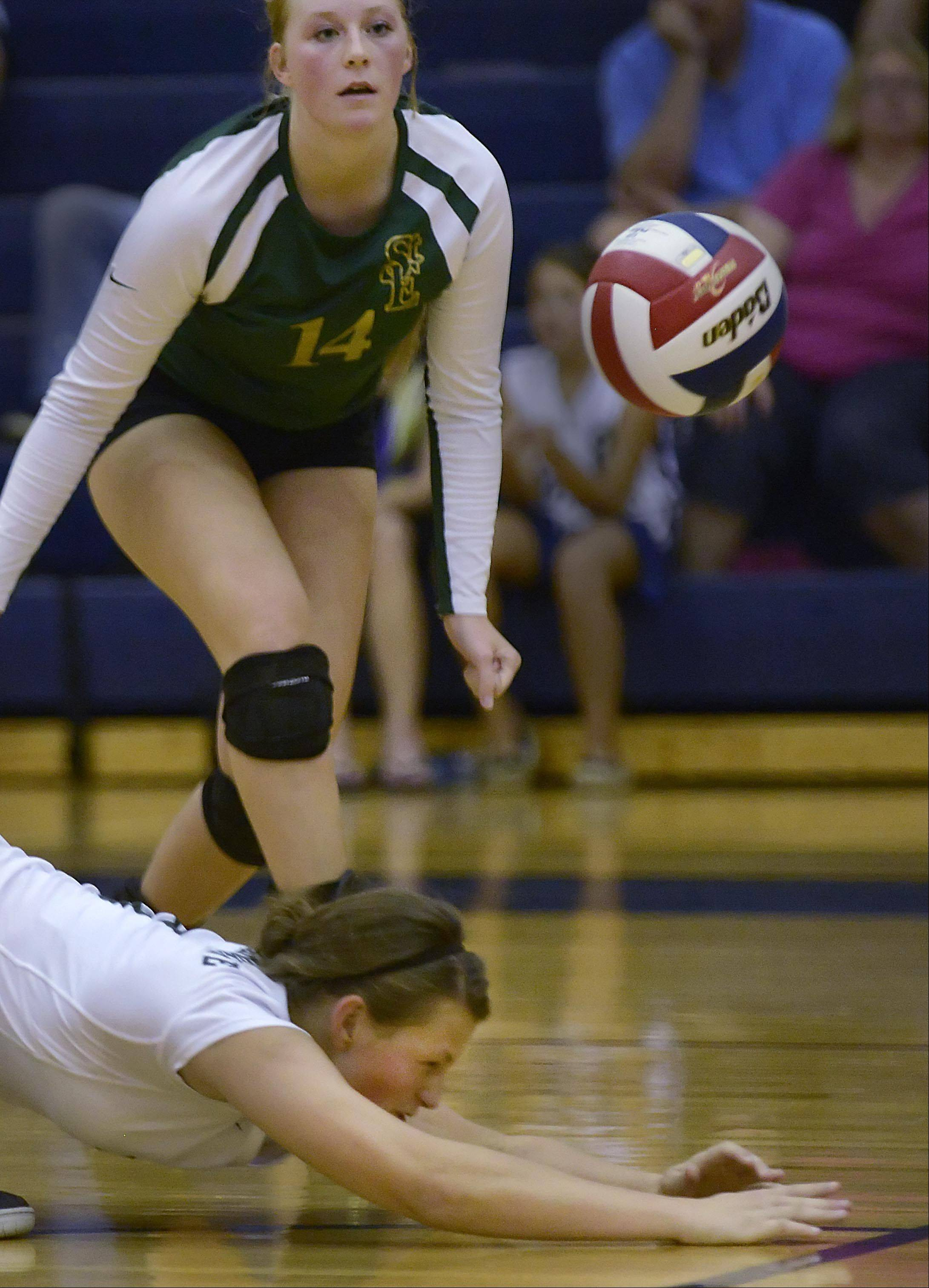 St. Edward's Allison Kruk hits the floor as she digs a shot by South Elgin during Wednesday's volleyball match in South Elgin.