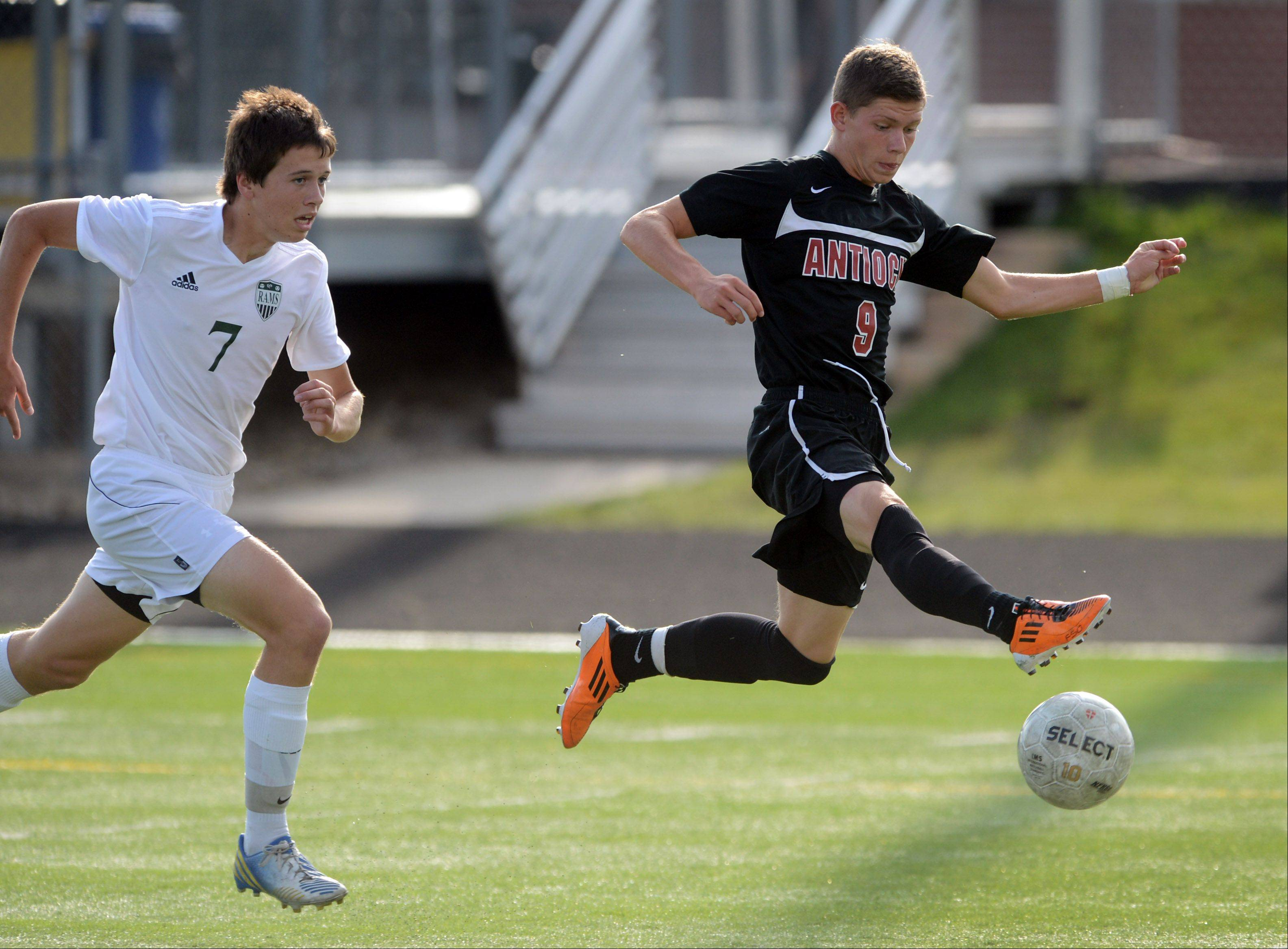 Antioch's Krystian Streit (9) controls the ball ahead of Grayslake Central's John Moroney during Wendesday's soccer match in Grayslake.