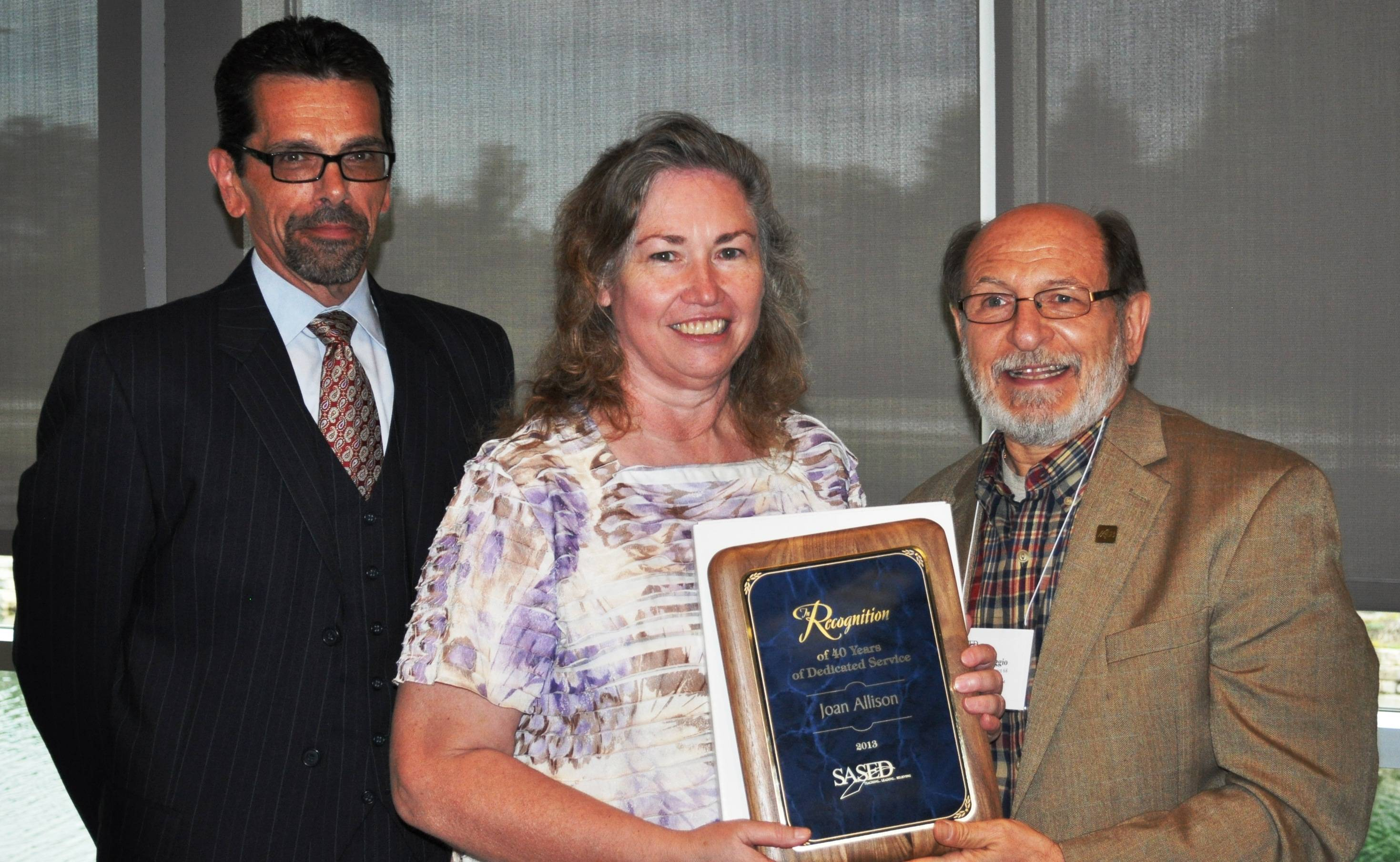 Joan Allison (center) receiving award from Tom Ruggio (right), SASED Board of Control Chairperson and Dr. Michael Volpe (left), SASED Executive Director