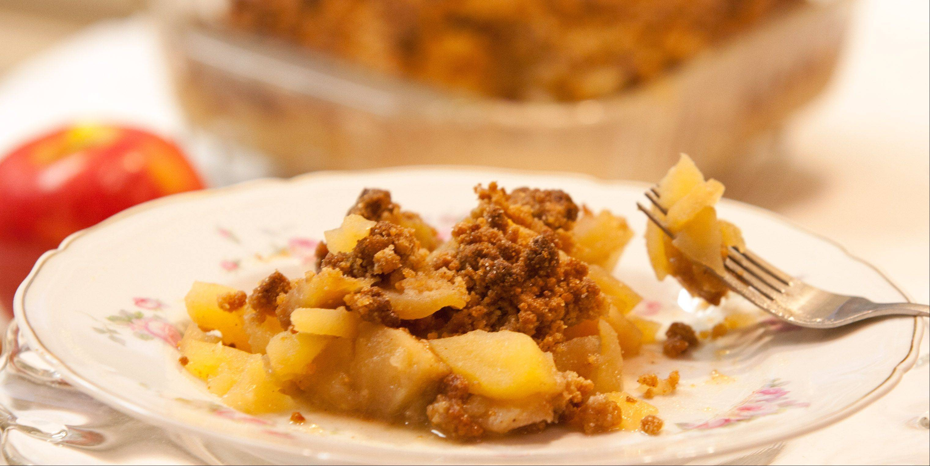 Nut flour and coconut flour combine with butter, spices and sugar to make a gluten-free topping for autumn apple crisp.