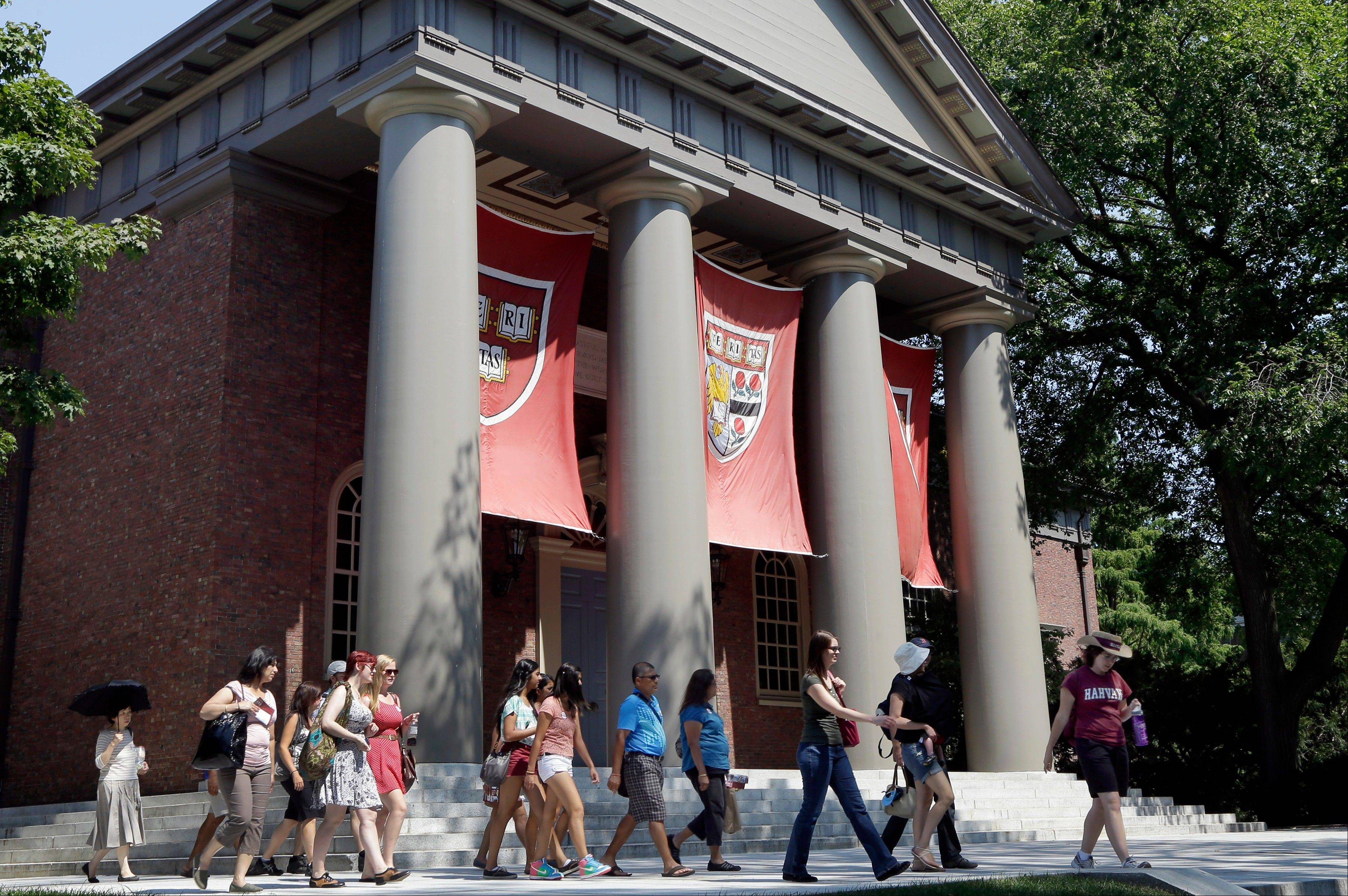 According to statistics released Sept. 10, 2103, by U.S. News & World Report, the average student receiving financial aid at Harvard, pictured, and Yale paid about a quarter of the sticker price and most graduates leave with smaller debt than peers who attended less prestigious schools.