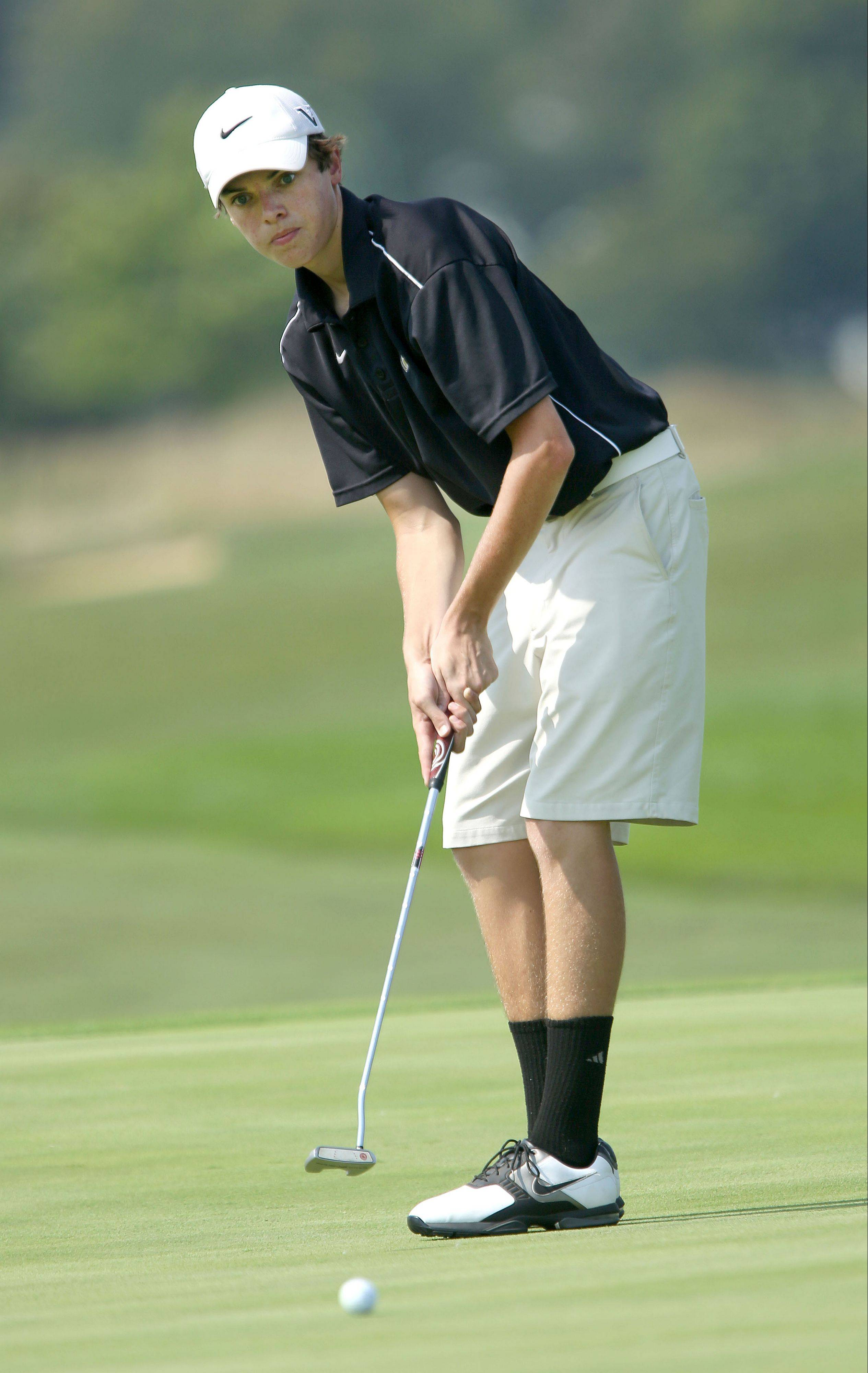 Grayslake North senior Kyle Sagendorph putts on No.8 during the Warren Open boys golf tournament at the Merit Club in Libertyville on Monday.