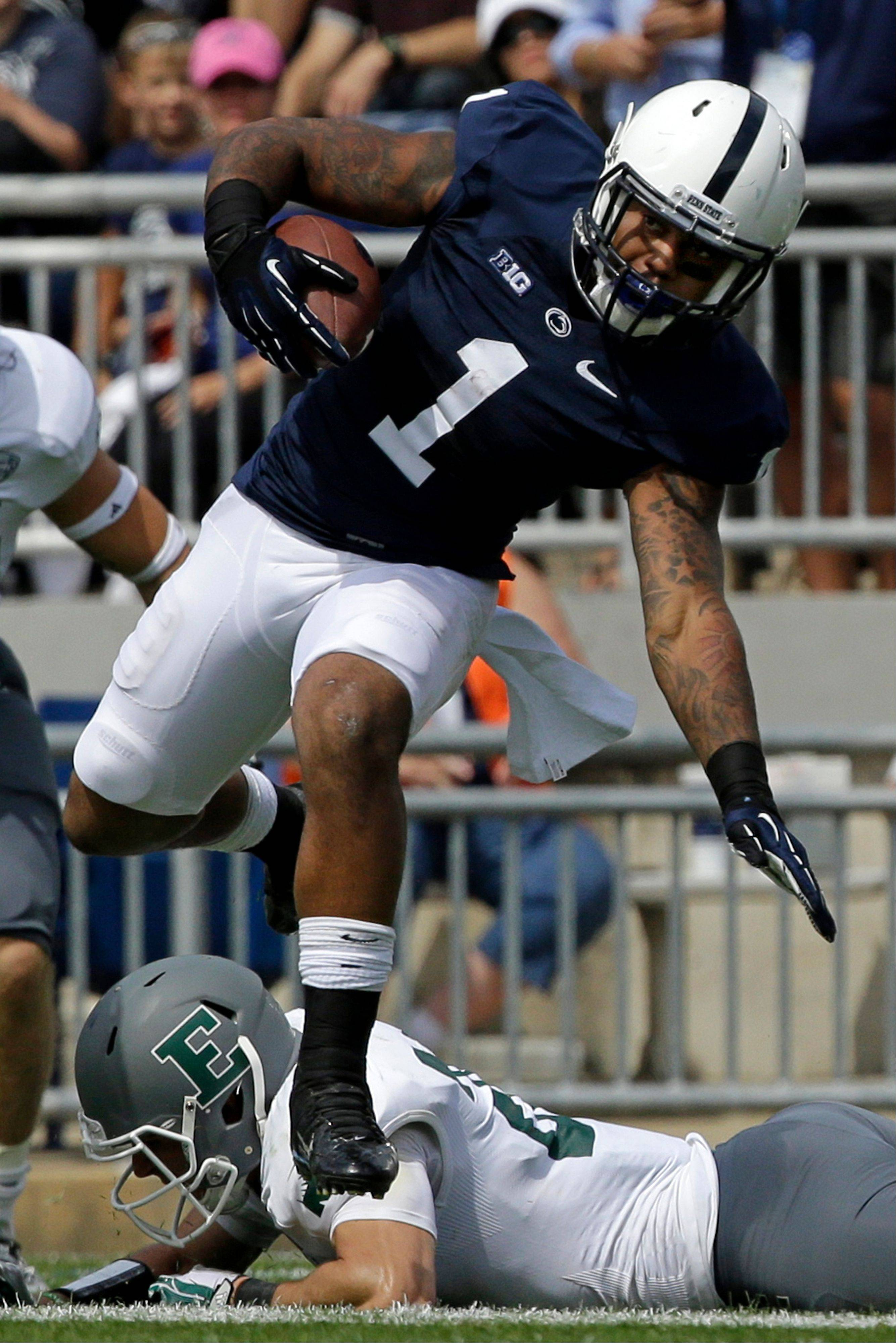Penn State running back Bill Belton leaps over an Eastern Michigan defender during the second quarter Saturday's game in State College, Pa.