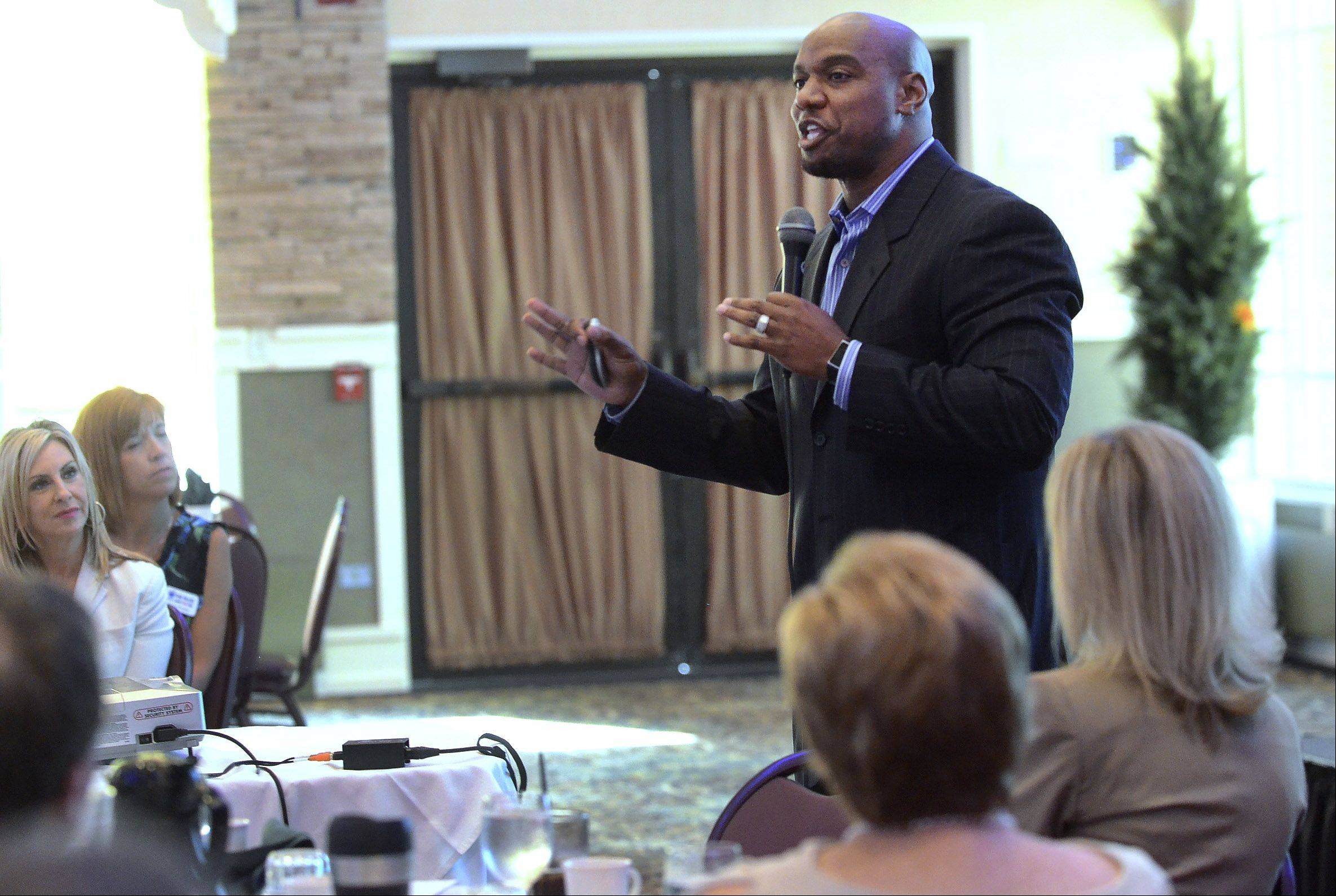 "Jarrett Payton delivers a talk on ""Discovering Your Greatness"" to the Schaumburg Business Association Tuesday."