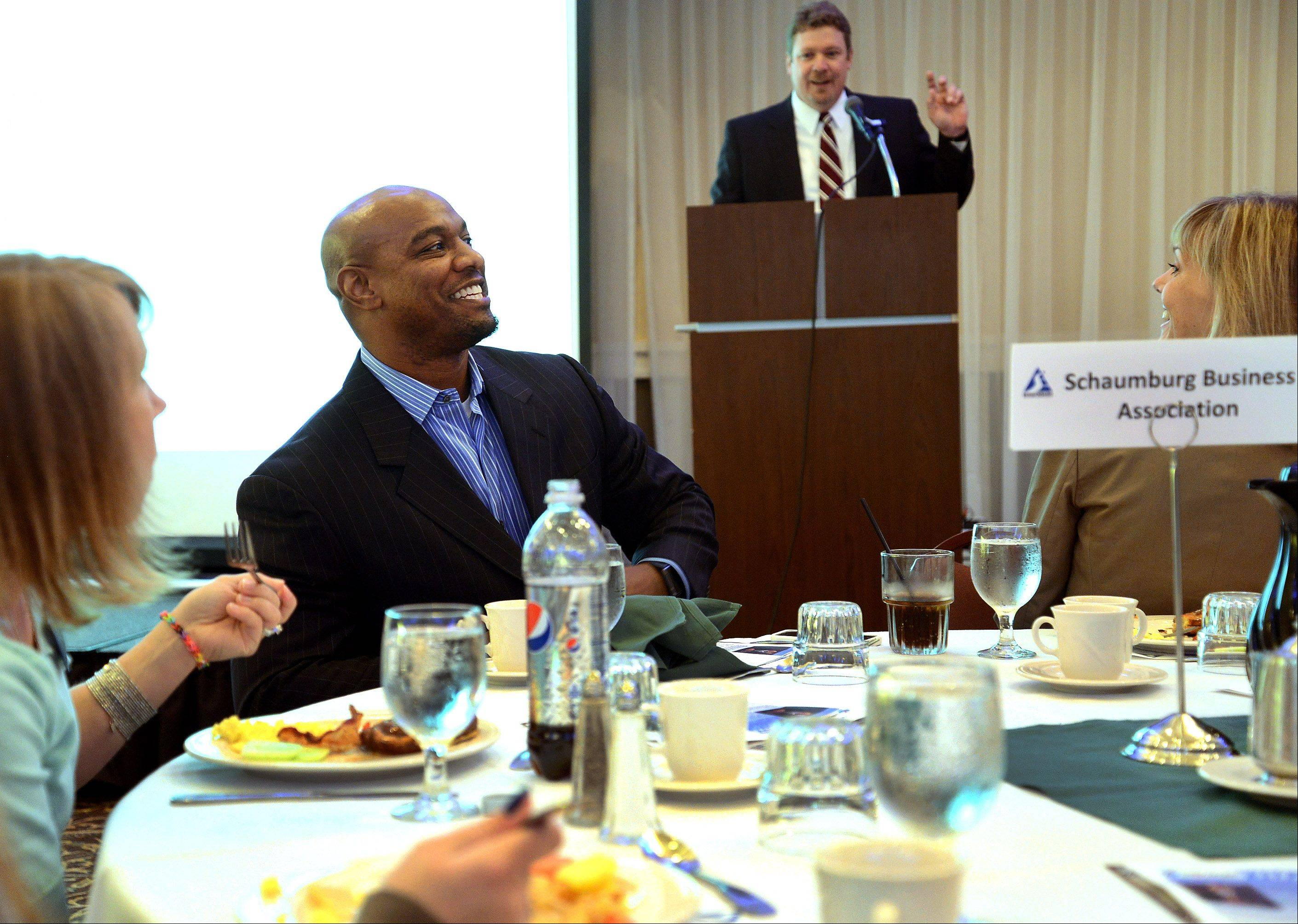 "Jarrett Payton is introduced by Scott Stone of the Daily Herald before delivering a talk on ""Discovering Your Greatness"" to the Schaumburg Business Association Tuesday."