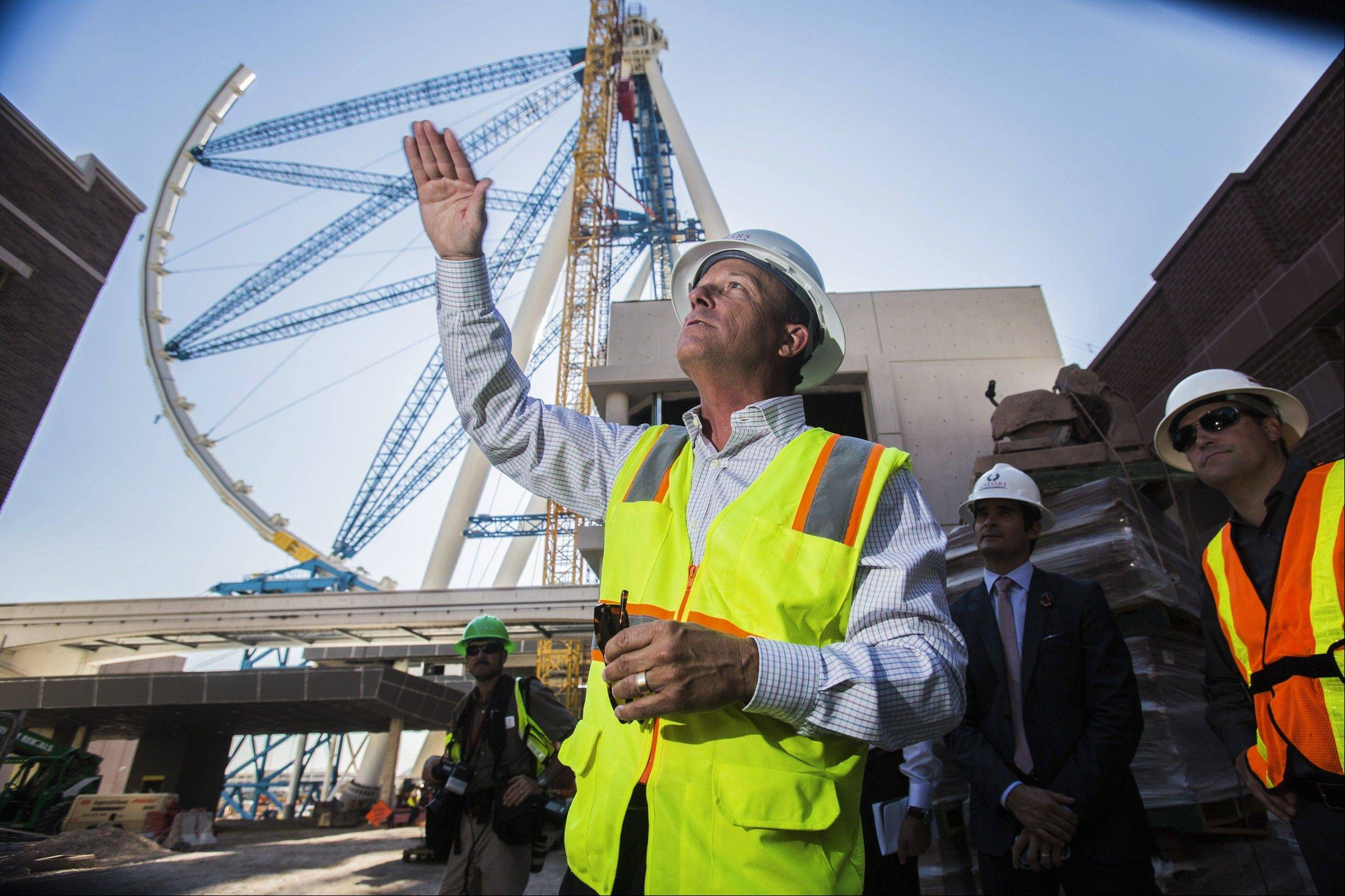 The world's tallest observation wheel, know as the High Roller is seen behind David Codiga, executive project director for The Linq, at The Linq construction site on Las Vegas Boulevard.