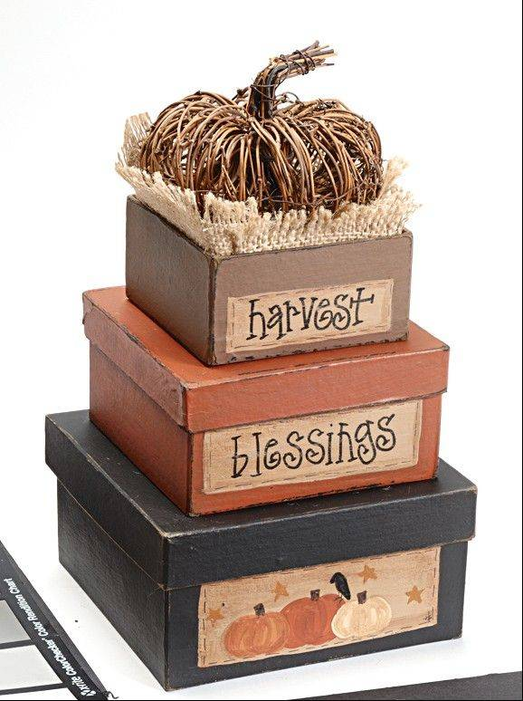 Instead of simply arranging stacking boxes in a tower and leaving it at that, open up more display possibilities. Take the lid off the top box, fill it with raffia, excelsior or a fabric square, and nestle in a plush jack-o'-lantern or a grapevine pumpkin.