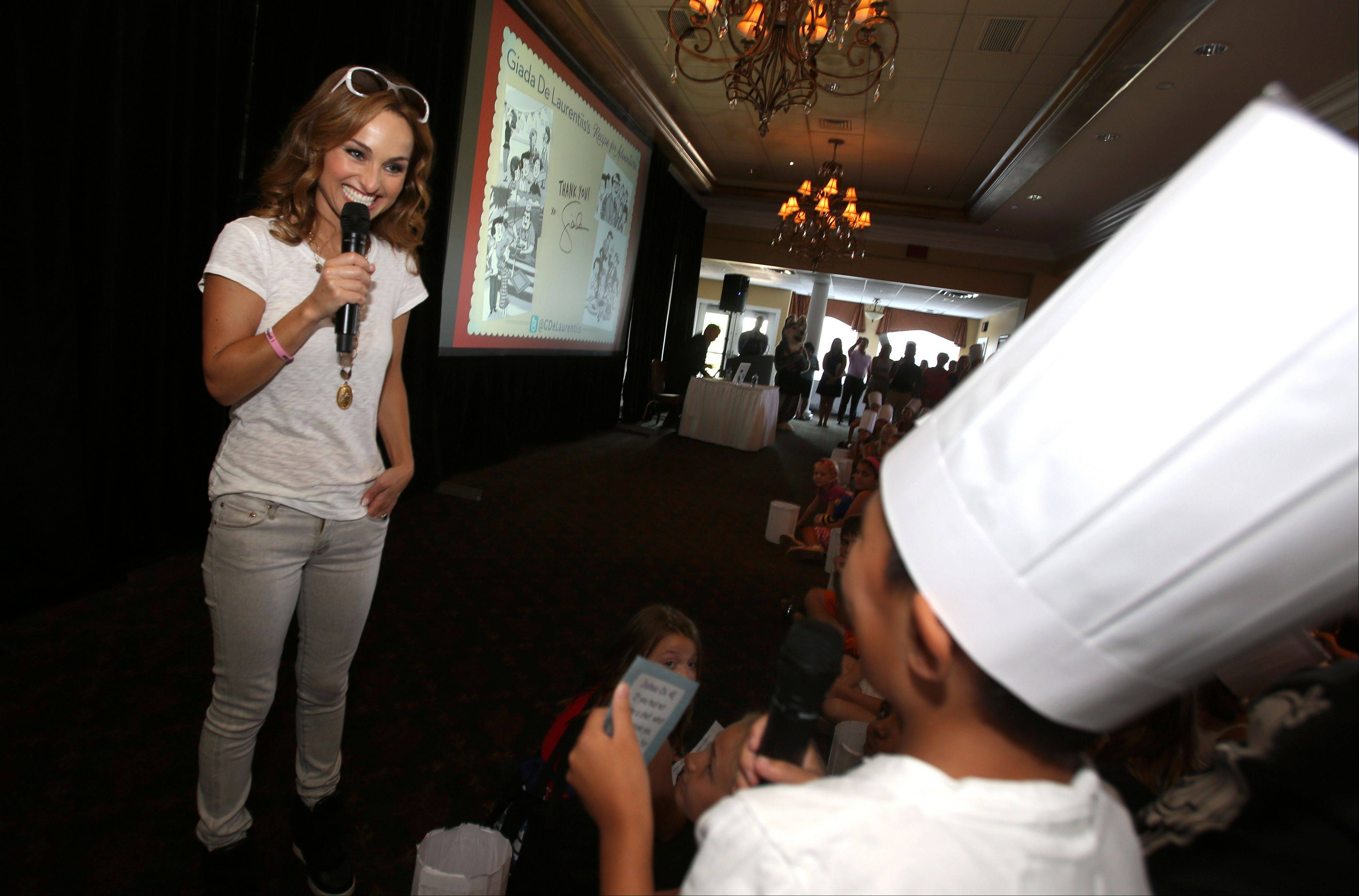Student Joshua Chi asks a question of Food Network star Giada De Laurentiis, who visited with students from White Eagle School in Naperville.
