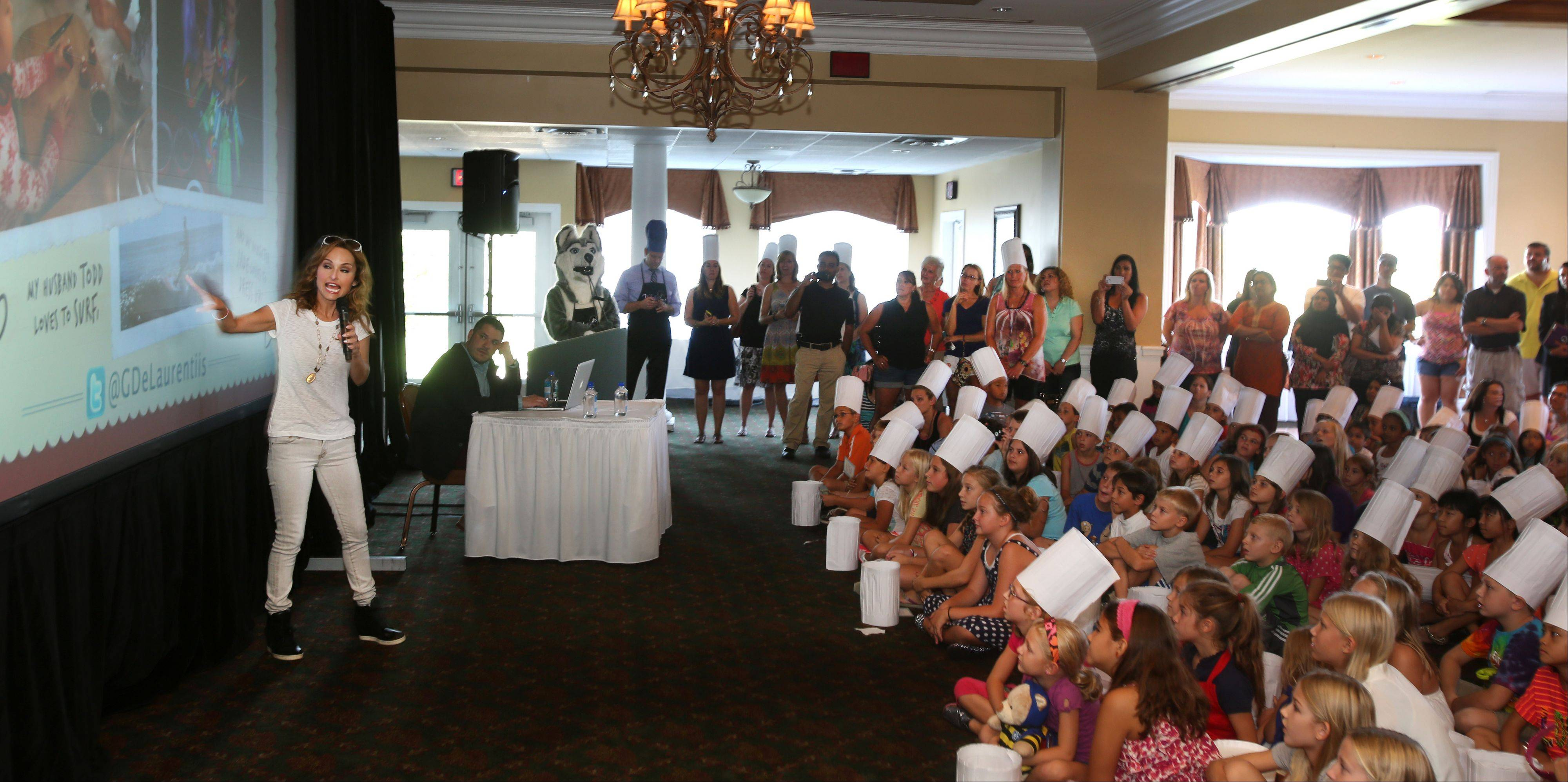 White Eagle elementary students in chef's hats stopped by the clubhouse in their Naperville/Aurora subdivision Tuesday to meet celebrity chef Giada De Laurentiis.