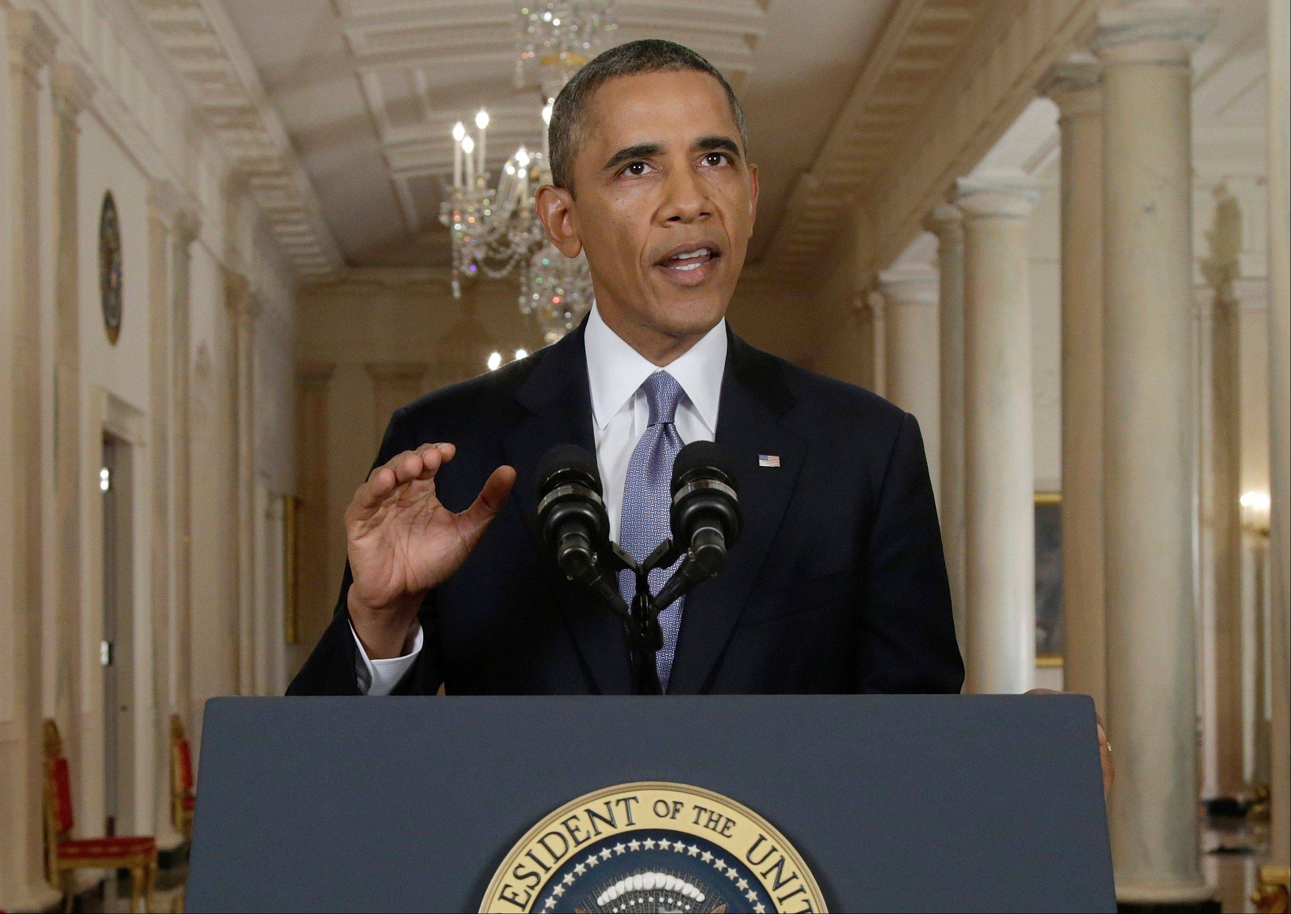 President Barack Obama addresses the nation in a live televised speech from the East Room of the White House in Washington. President Obama blended the threat of military action with the hope of a diplomatic solution as he works to strip Syria of its chemical weapons.