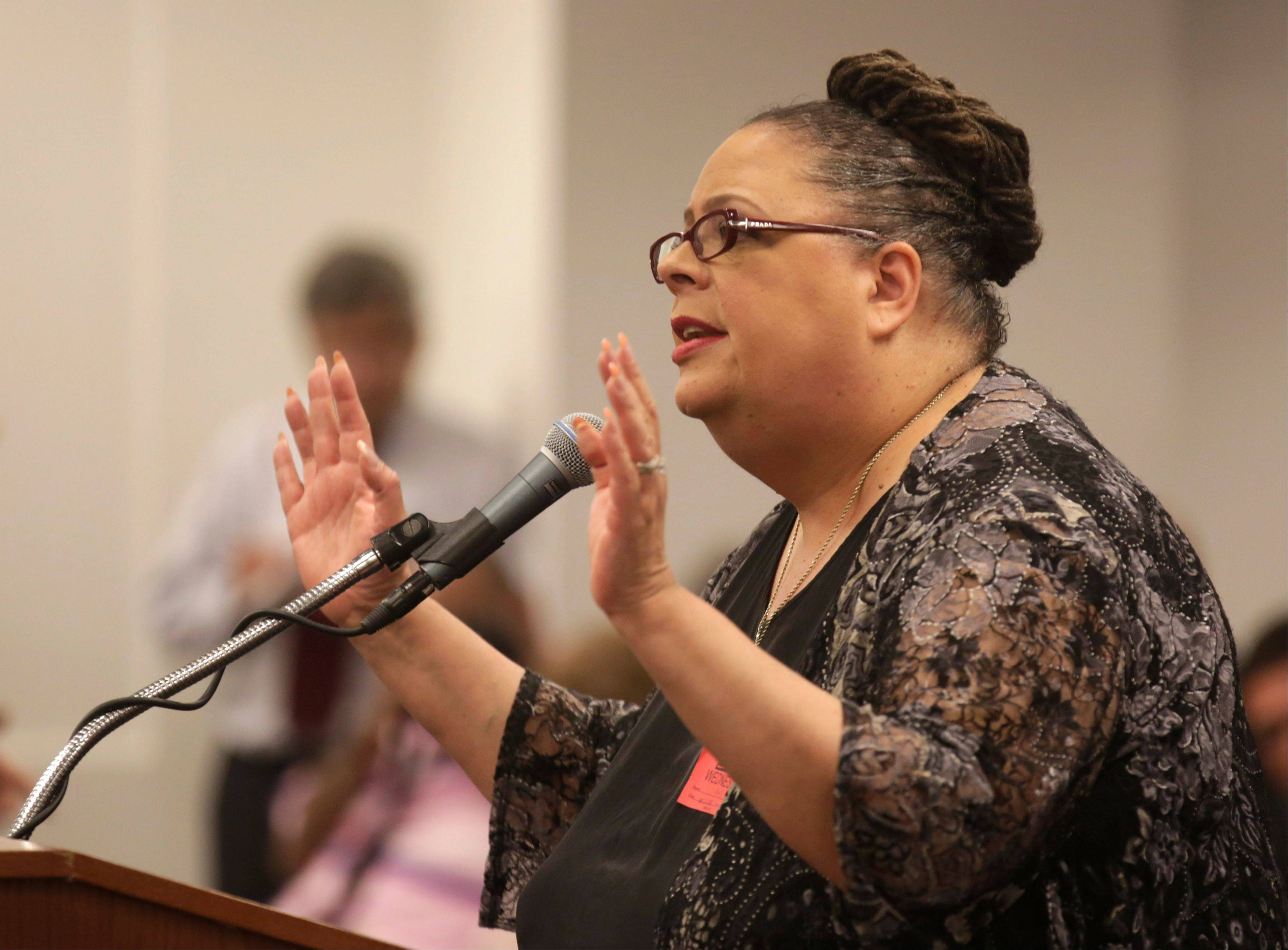 Chicago Teachers Union President Karen Lewis speaks at a packed meeting of the Chicago Board of Education on May 22 to protest school closings.