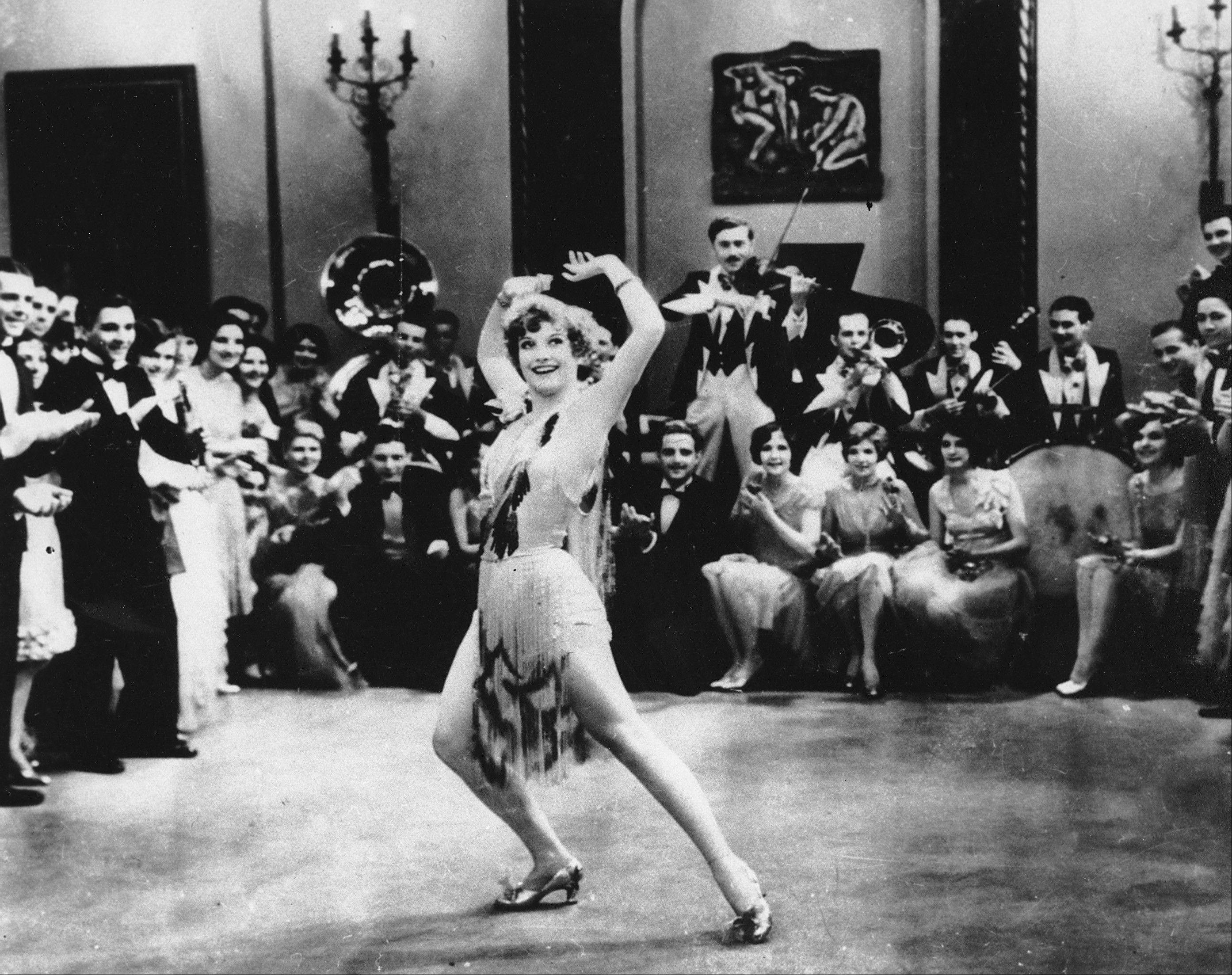"In this 1928 file photo, actress Joan Crawford is seen dancing the Charleston in ""Our Dancing Daughters"" in Hollywood, Calif. A report released Tuesday shows the very wealthiest Americans earned more than 19 percent of the country�s household income in 2012, their biggest share since 1928."