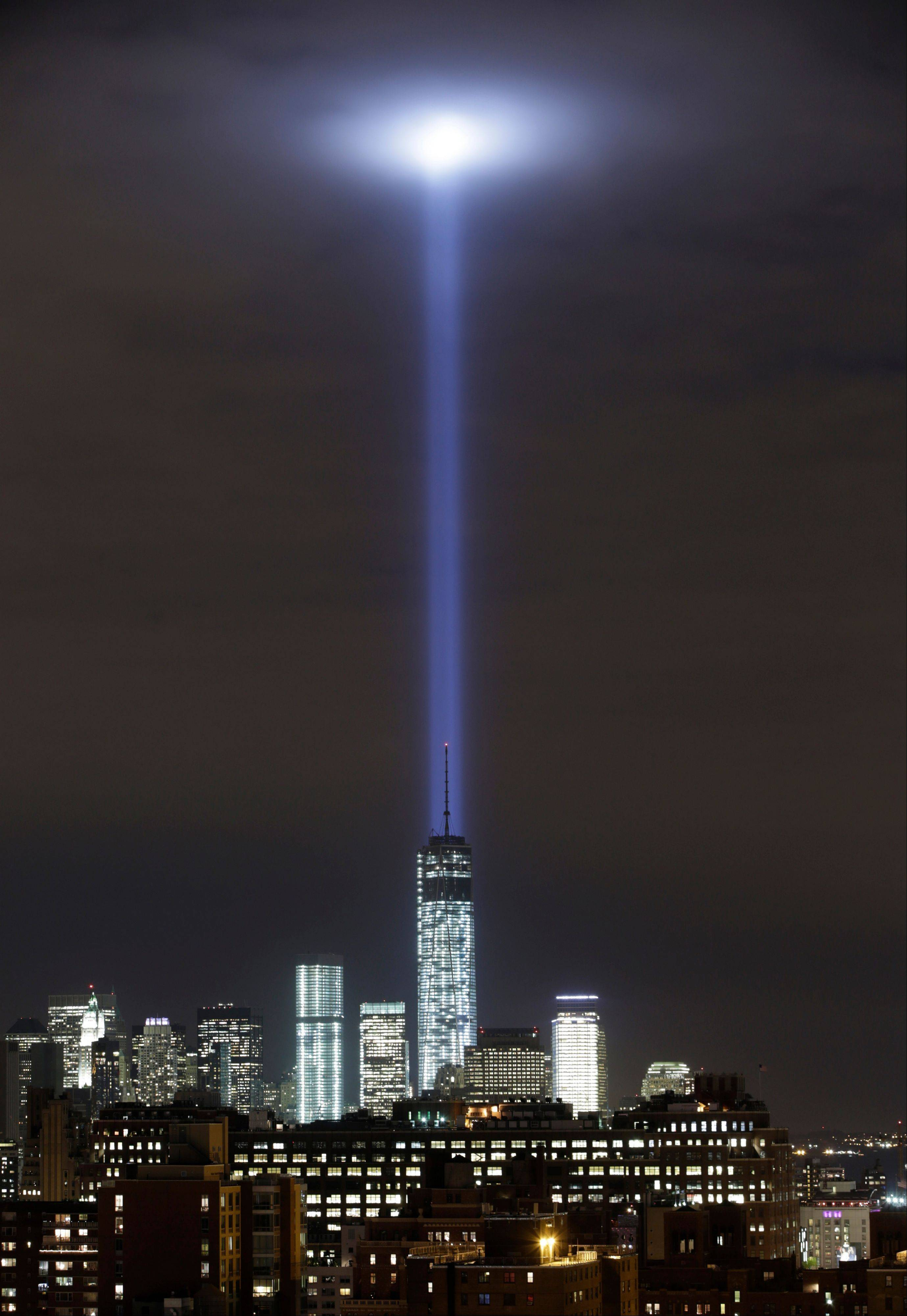 A test of the twin beams of the Tribute in Light intersect with the still-under construction Tower One as they rise behind the building and above lower Manhattan Monday. The memorial will light the sky on the evening of Sept. 11, 2013, in honor of those who died in the Setp. 11, 2001, terror attacks on the United States.