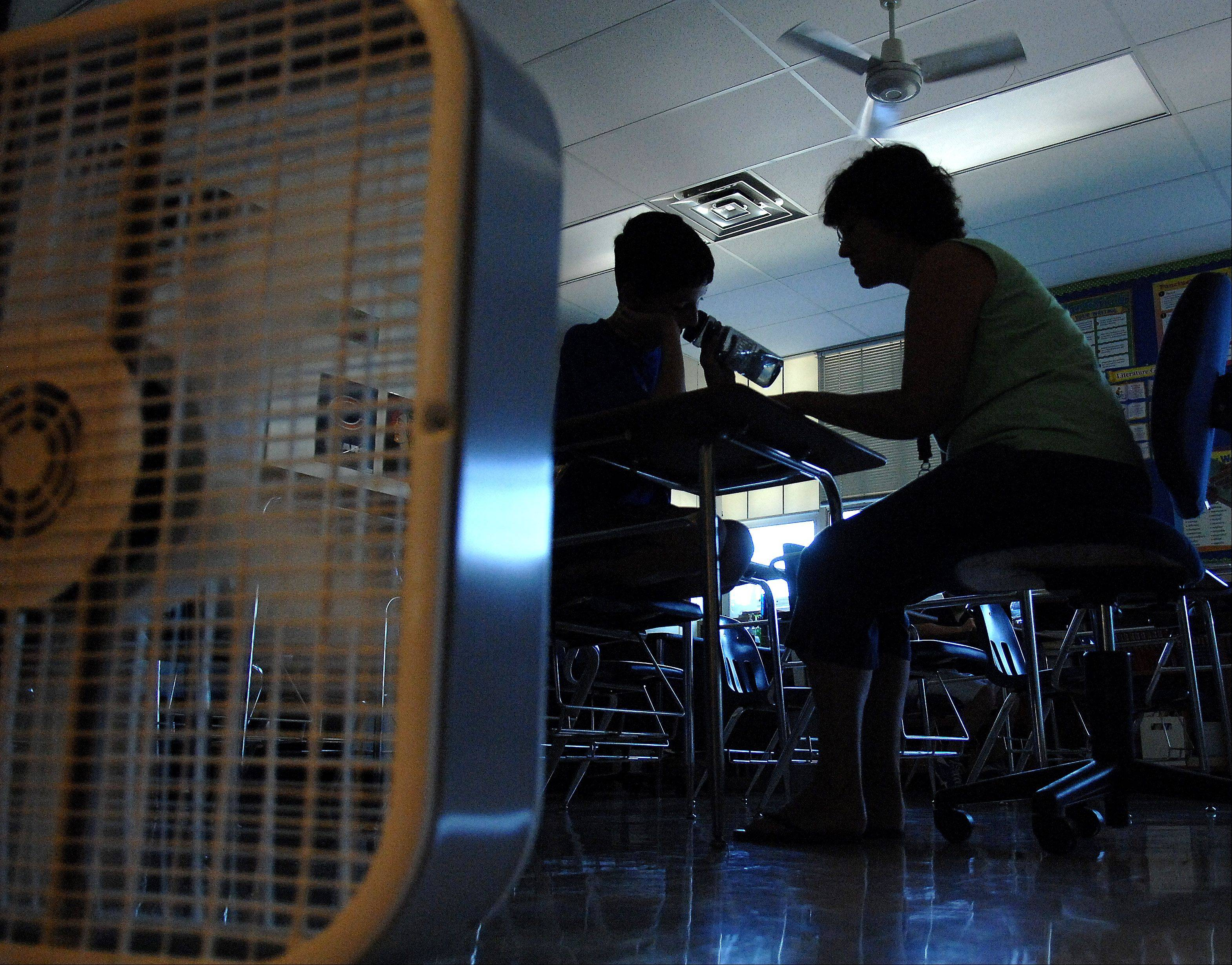 Fans, water and lights off were among the ways that Thompson Middle School teachers and students tried to keep cool without air conditioning and temperatures expected to hit the mid-90s Tuesday in St. Charles.