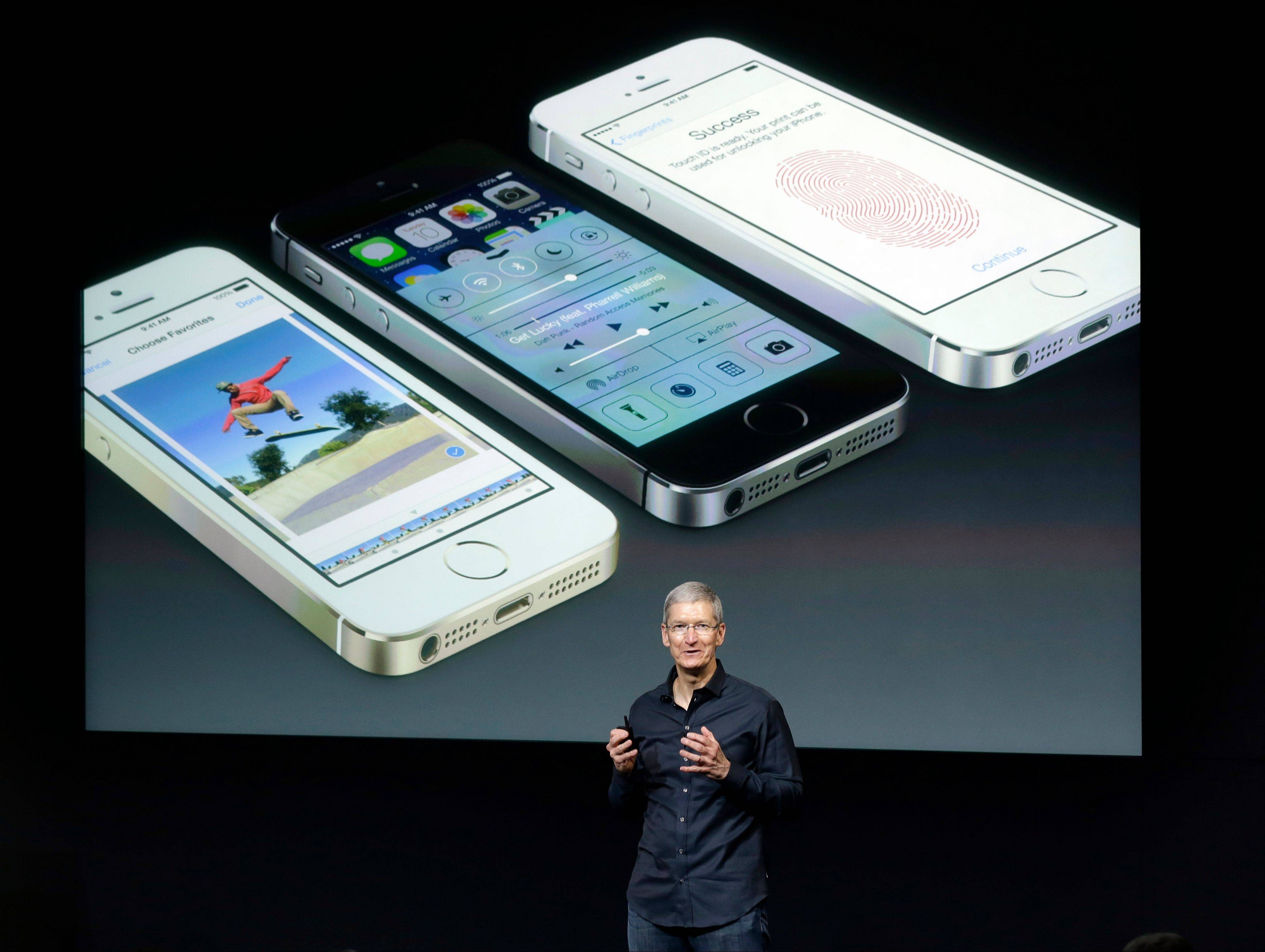 Tim Cook, CEO of Apple, speaks on stage during the introduction of the new iPhone 5s in Cupertino, Calif., Tuesday, Sept. 10, 2013.