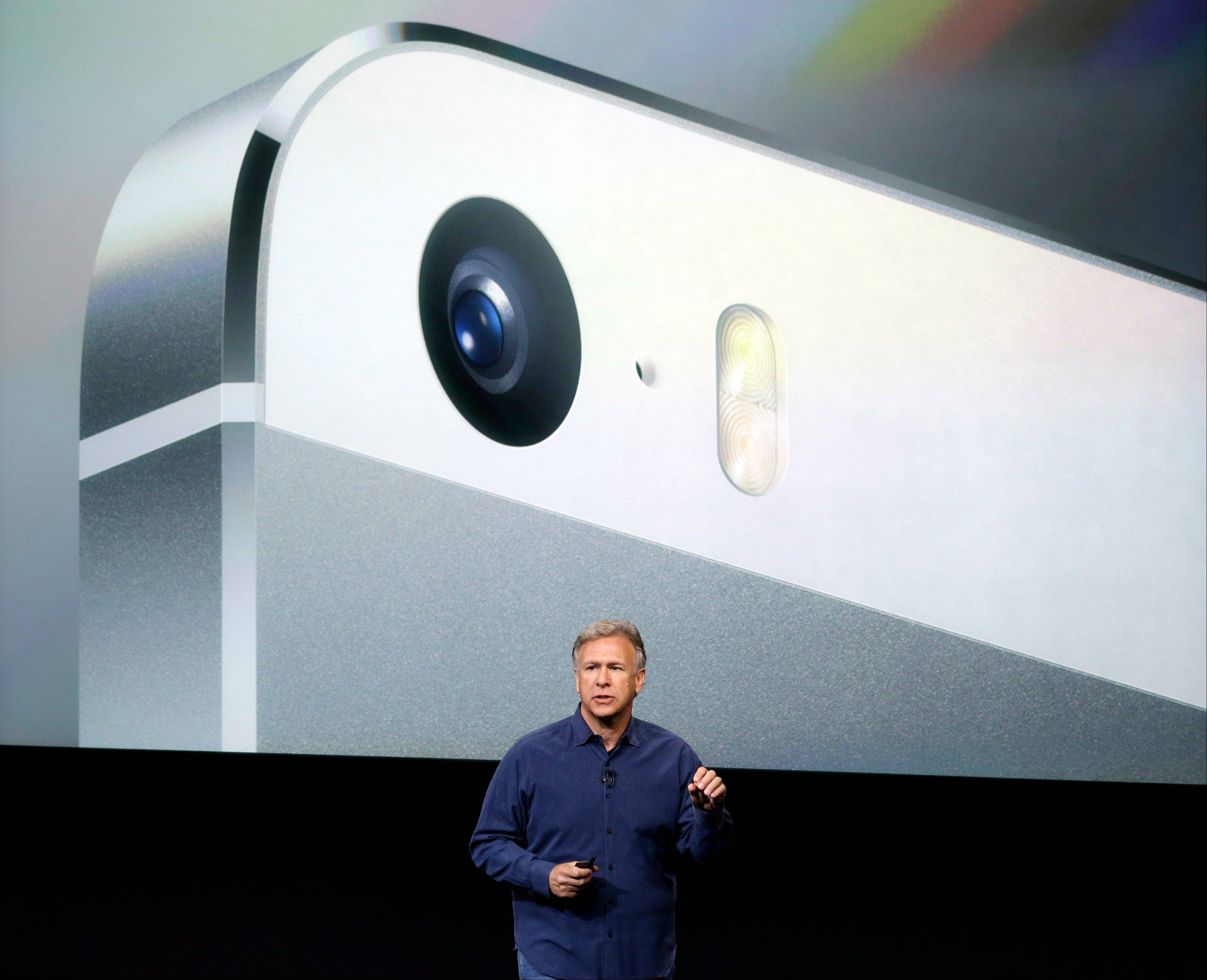 Phil Schiller, Apple's senior vice president of worldwide product marketing, speaks on stage about the camera quality during the introduction of the new iPhone 5s in Cupertino, Calif., Tuesday, Sept. 10, 2013.