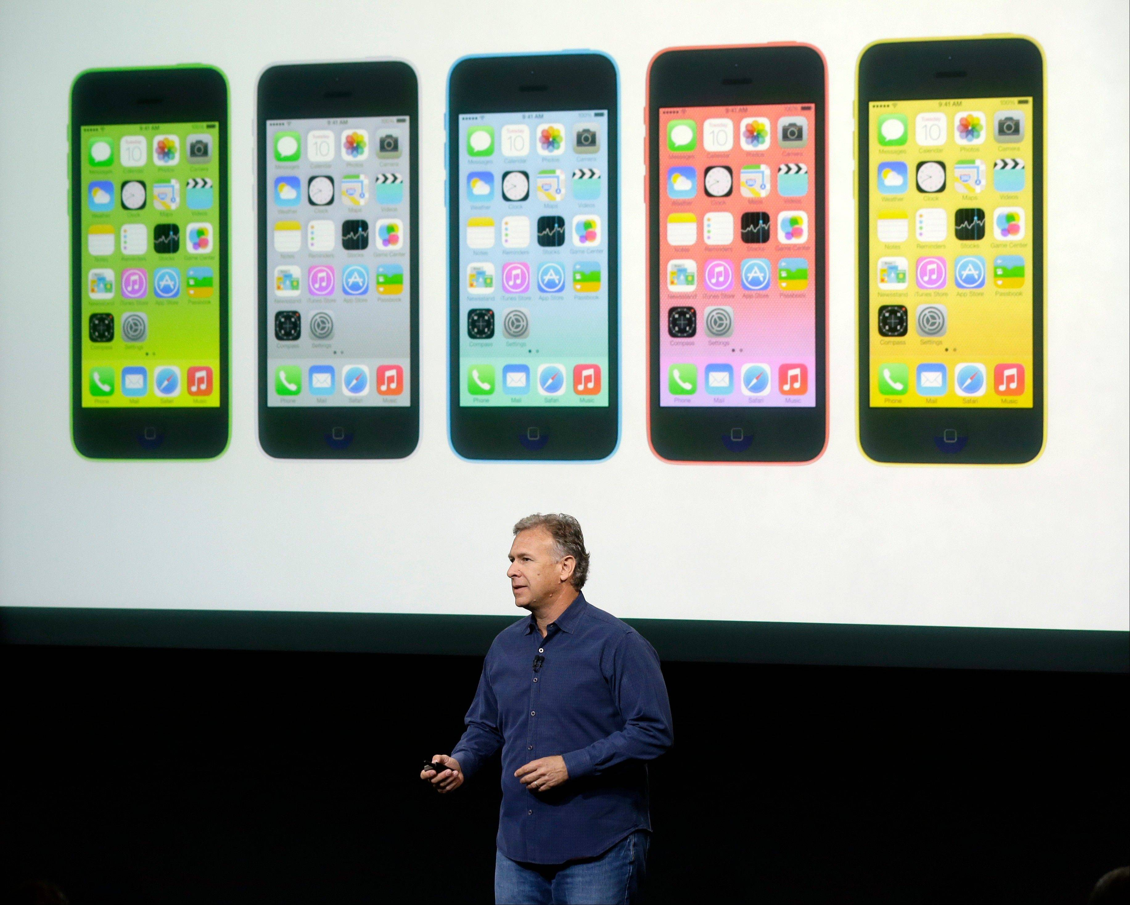 Phil Schiller, Apple's senior vice president of worldwide product marketing, speaks on stage during the introduction of the new iPhone 5c in Cupertino, Calif., Tuesday, Sept. 10, 2013.