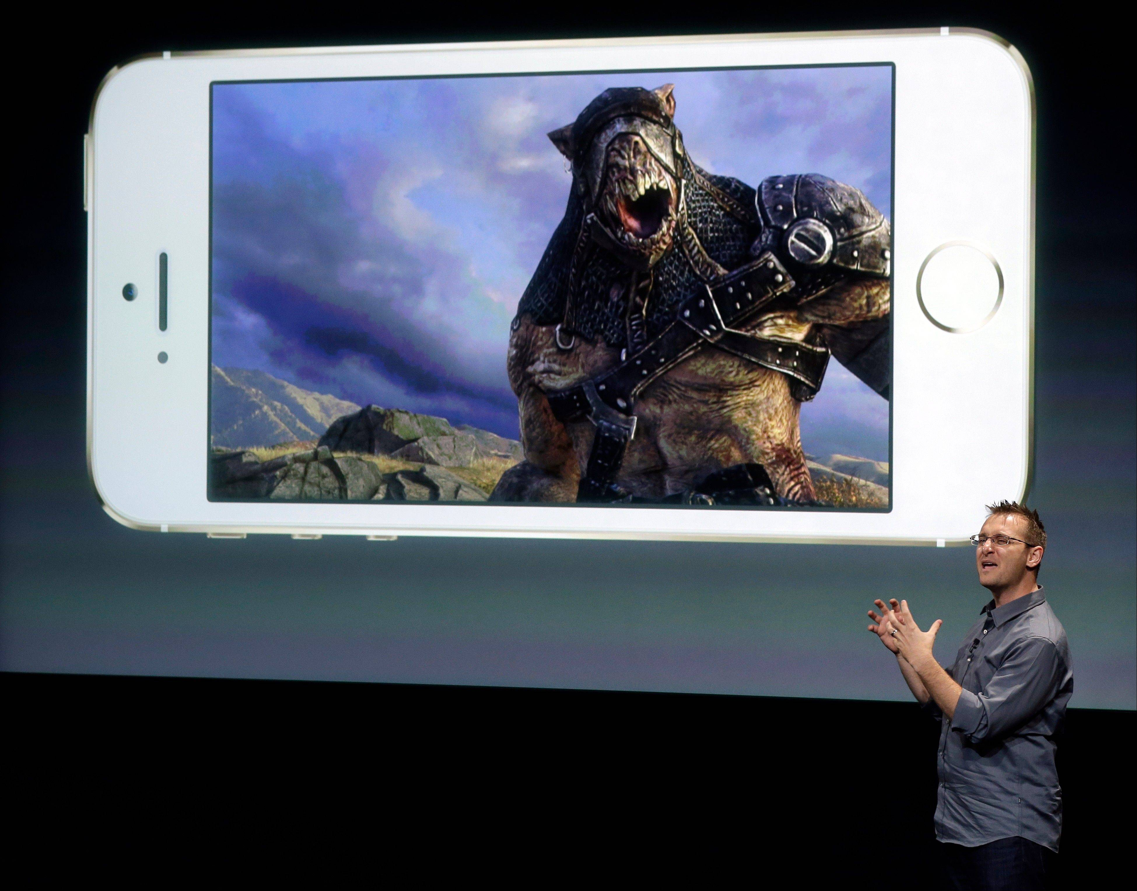 Donald Mustard, CEO of Epic Games, speaks on stage during the introduction of the new iPhone 5s in Cupertino, Calif., Tuesday, Sept. 10, 2013.