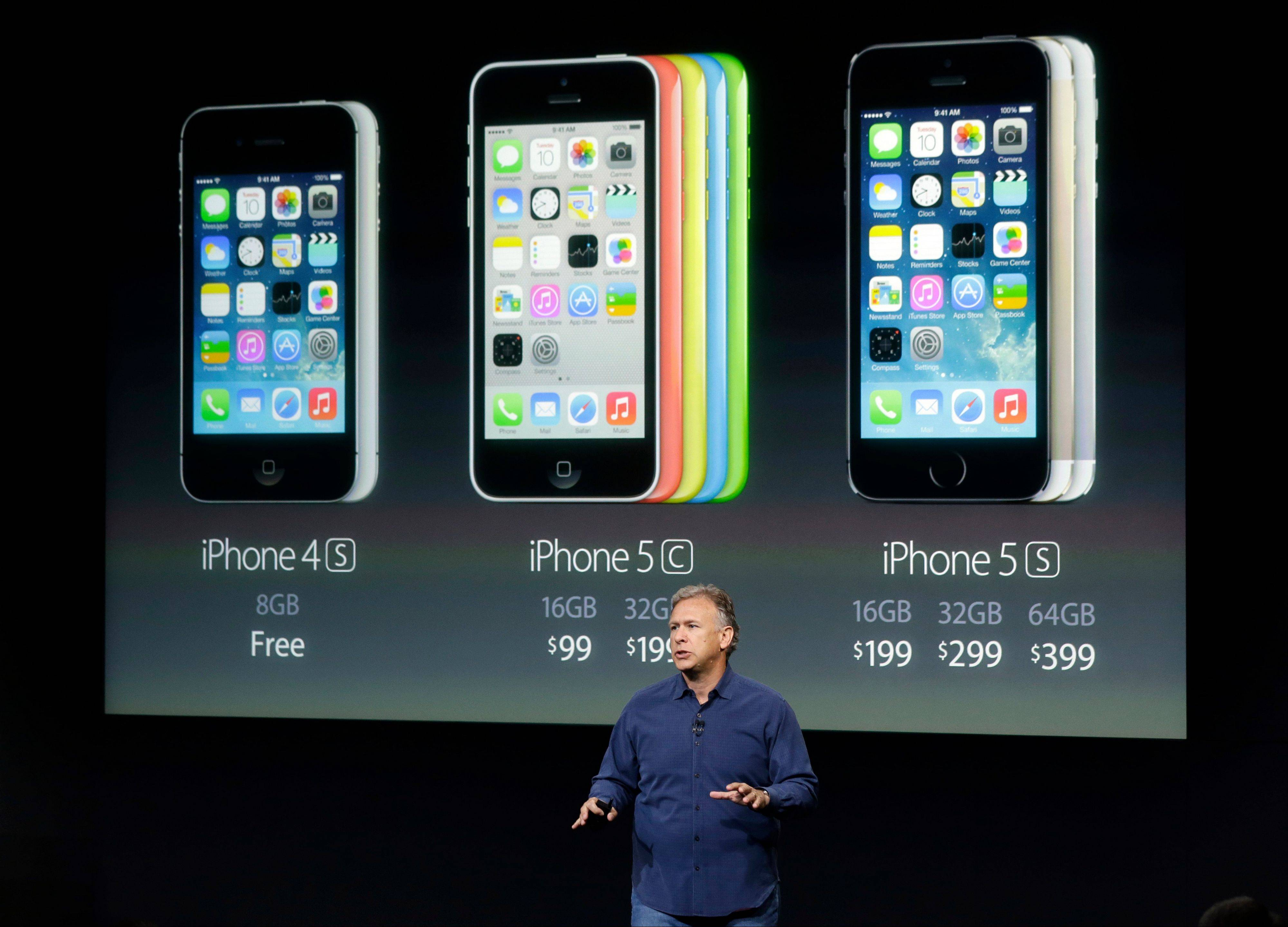 Phil Schiller, Apple's senior vice president of worldwide product marketing, speaks on stage during the introduction of the new iPhone 5c and 5s in Cupertino, Calif., Tuesday, Sept. 10, 2013.