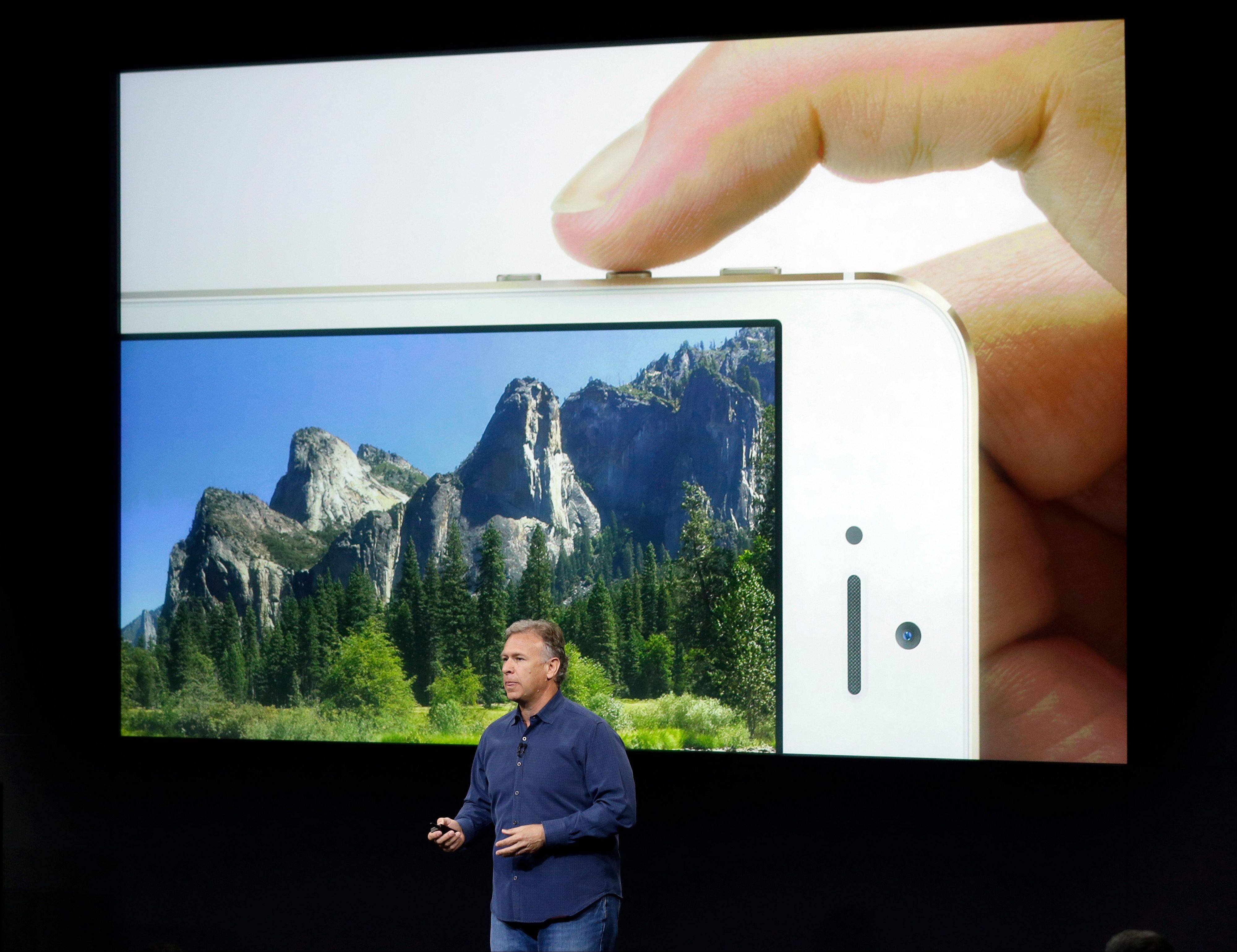Phil Schiller, Apple's senior vice president of worldwide product marketing, speaks on stage about the camera quality during the introduction of the new iPhone 5s in Cupertino, Calif., Tuesday, Sept. 10, 2013. Apple�s latest iPhones will come in a bevy of colors and two distinct designs, one made of plastic and the other that aims to be �the gold standard of smartphones and reads your fingerprint.