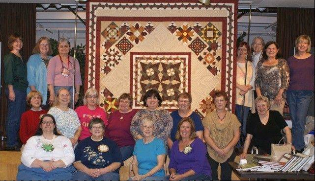 About 40 members of the Faithful Circle Quilters Guild contributed their time and talents to create a quilt designed in part by Judy Pacanowski, front row at far right. Annabelle Jankowiak, middle row, fifth from left, made the center medallion of the quilt, which will be auctioned at the group's quilt show for charity.