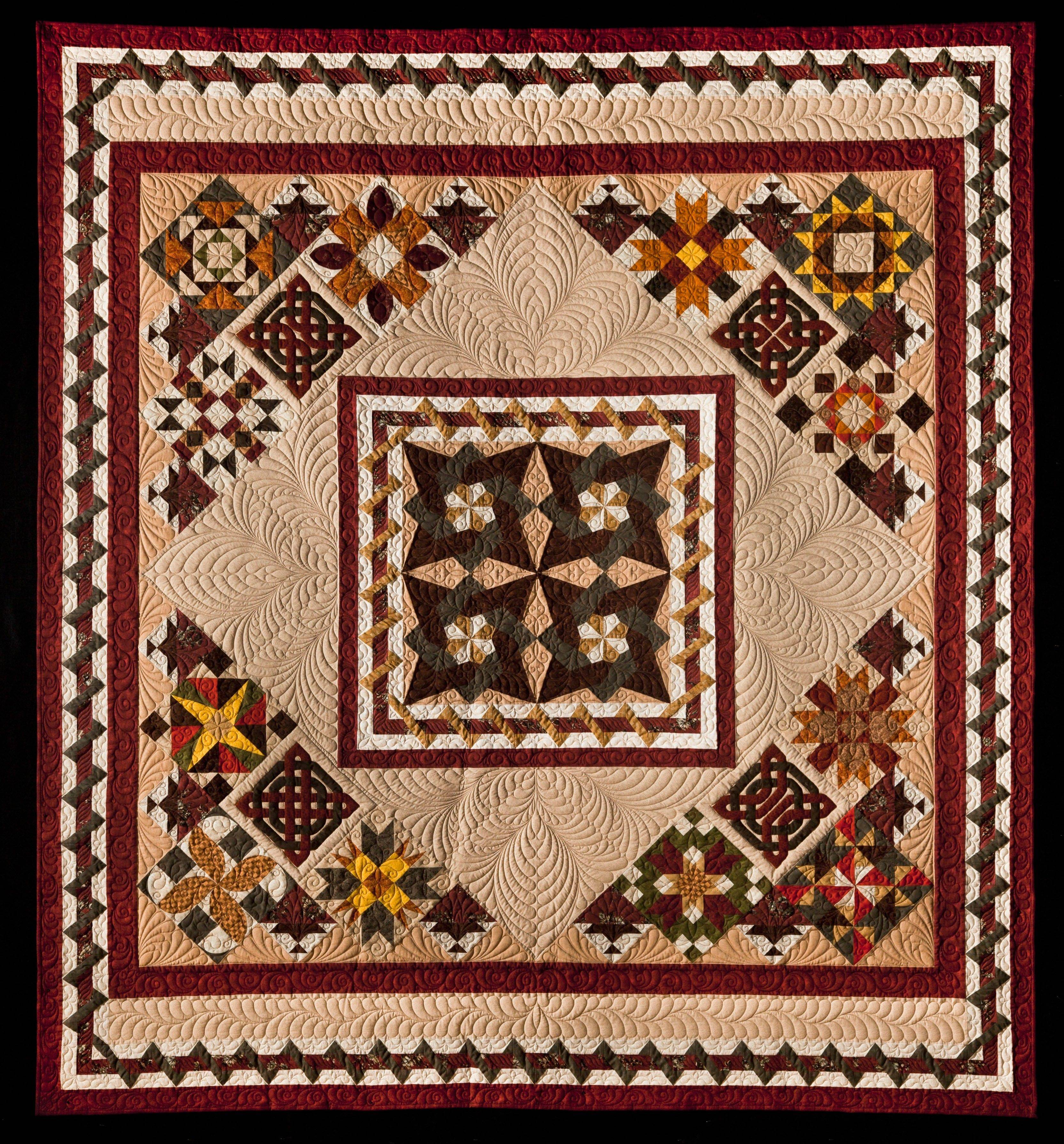"The quilt, ""The Autumn Wind,"" will be raffled at the 2013 Quilt Show organized by the Faithful Circle Quilters. Two years in the making, the quilt is the work of 40 guild members."
