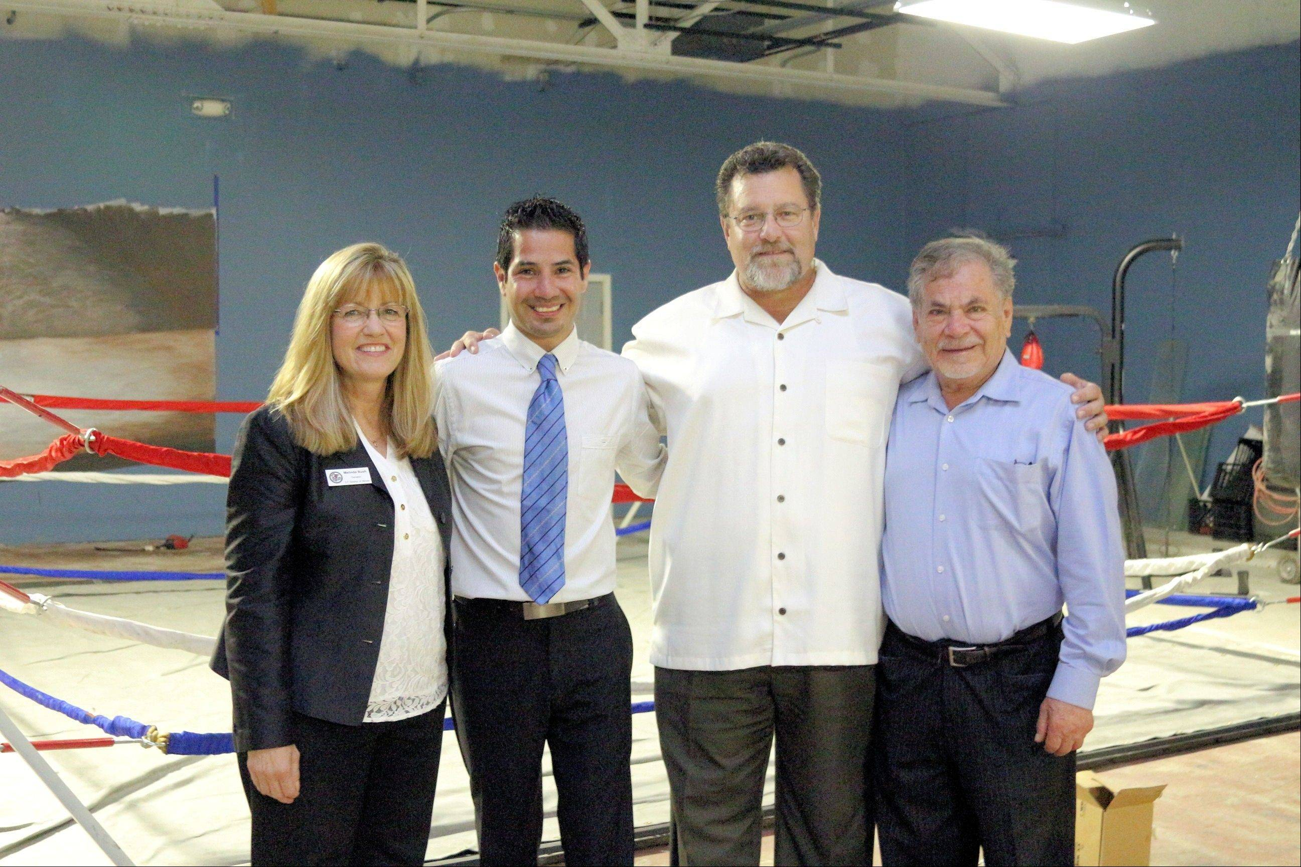 State Sen. Melinda Bush, Jose Hernandez Jr., Round Lake Mayor Dan MacGillis, and Jose Hernandez Sr. at the All Star Boxing gym fundraiser.