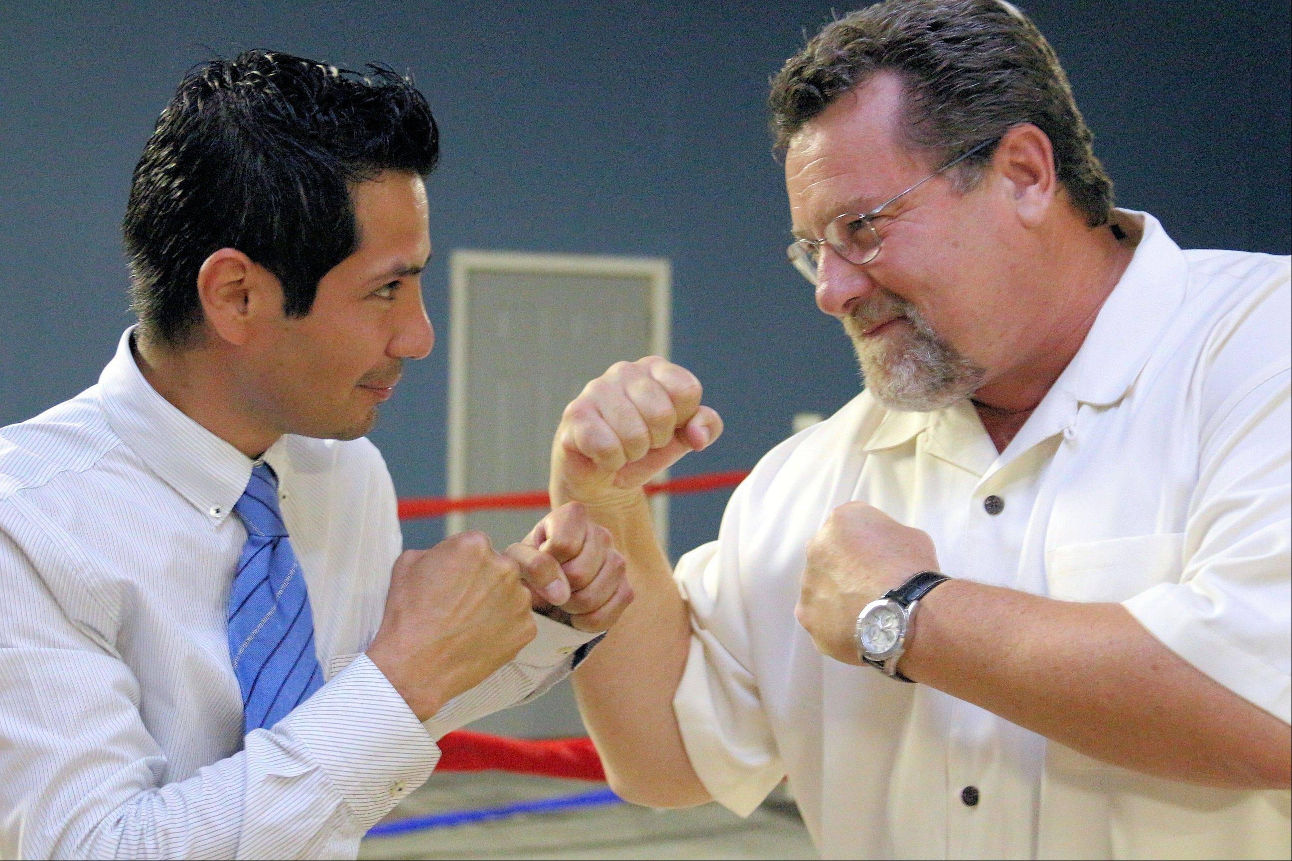 Jose Hernandez Jr. squares off with Round Lake Mayor Dan MacGillis. Hernandez grew up in the Round Lake area and has been boxing since he was 15.