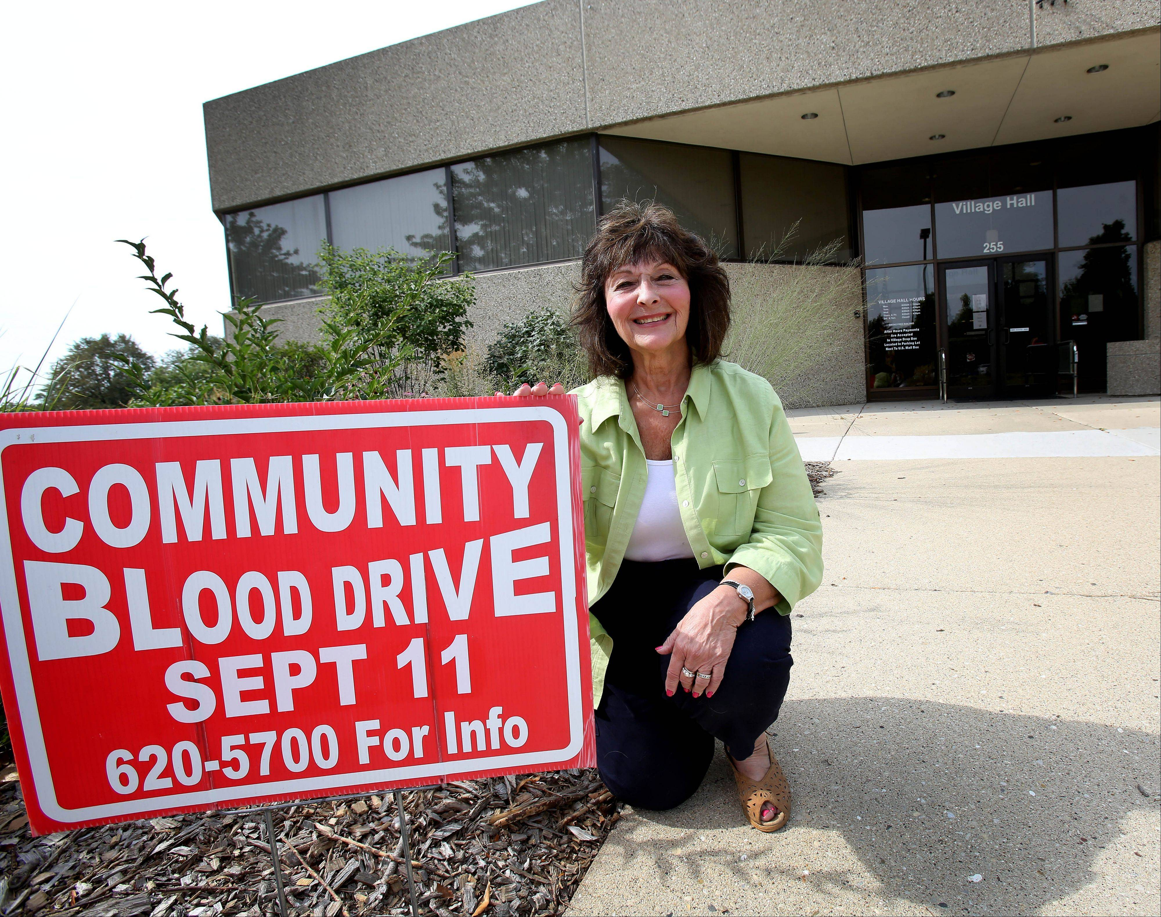 "Carol Bauer, executive coordinator for the village of Lombard, enlists village employees and volunteers to promote the village blood drives. Her dedication has earned her an award for being the state's ""Most Dedicated"" blood drive coordinator."