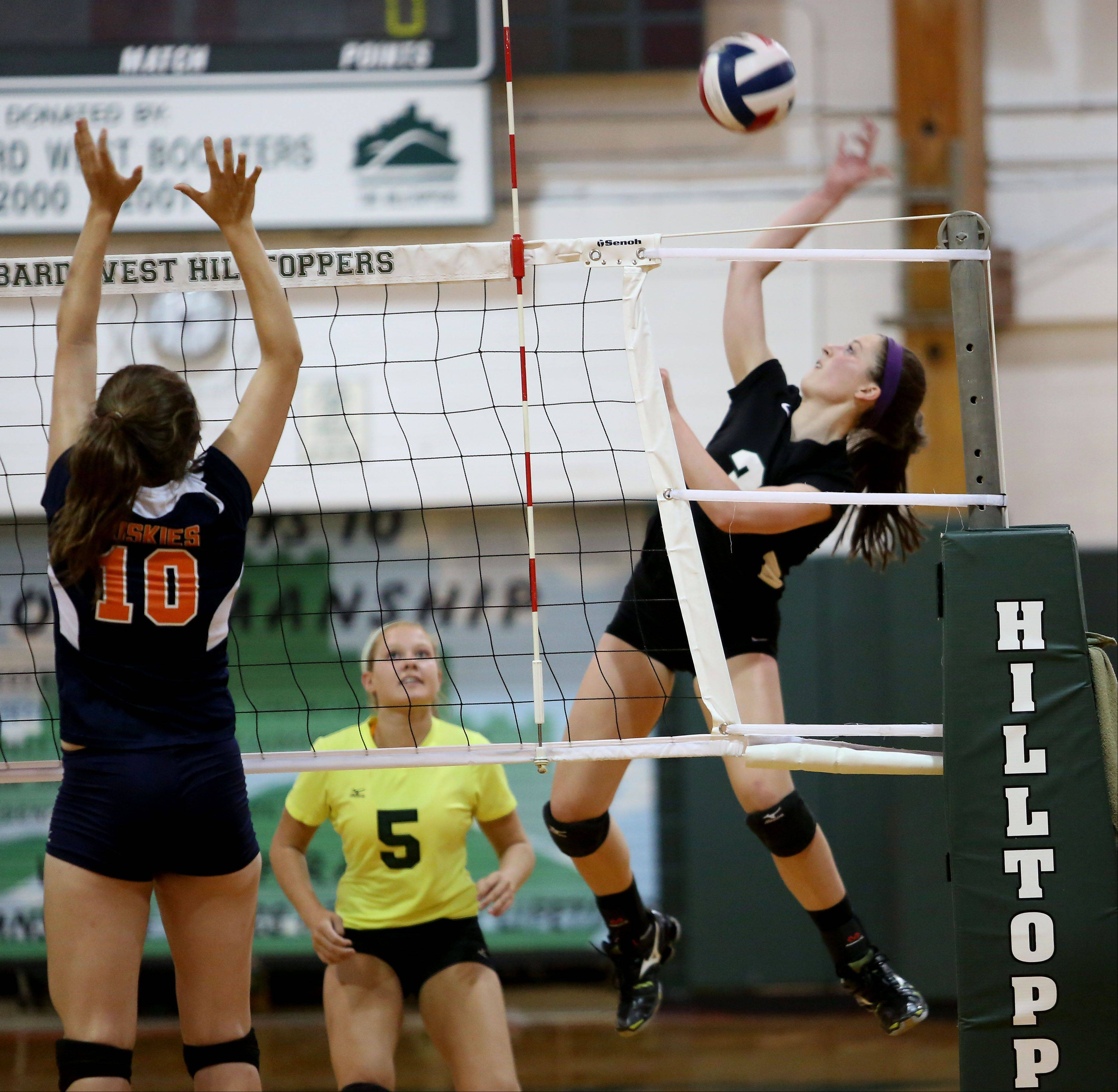 Alison Burelbach of Glenbard West goes up to spike the ball against Oak Park River Forest girls volleyball on Tuesday in Glen Ellyn.