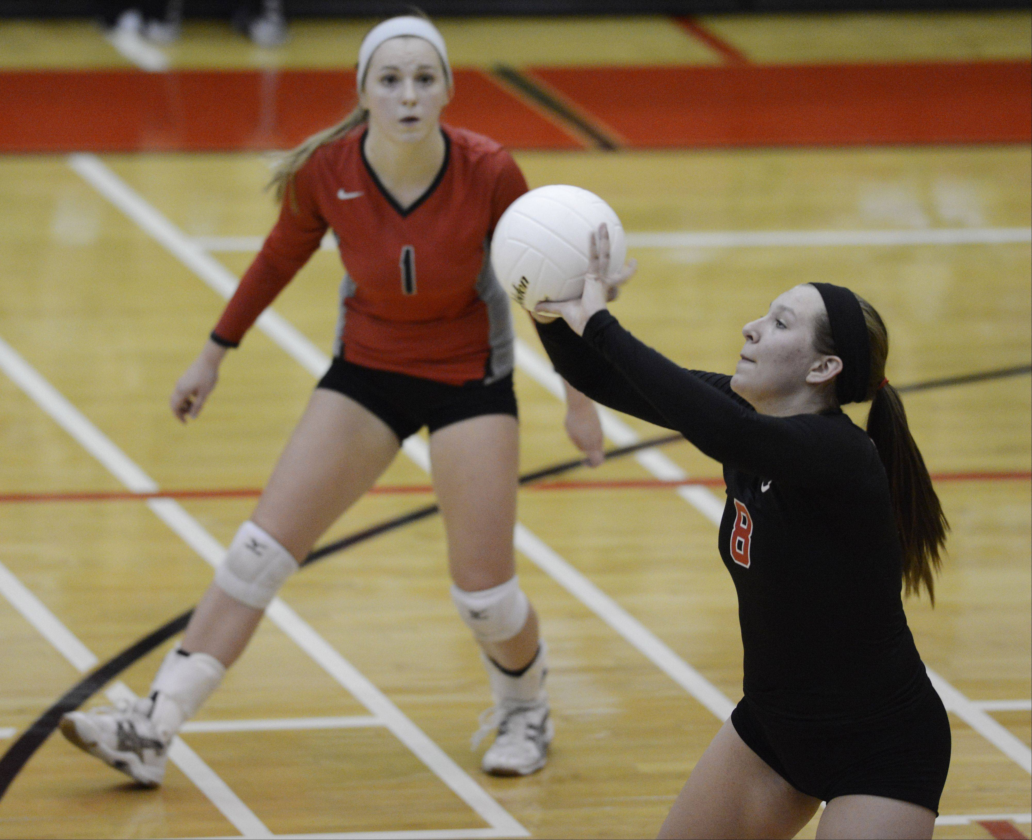 Palatine's Meg Angelaccio returns a serve as teammate Liz Keelty stands at the ready during Tuesday's match against Conant.
