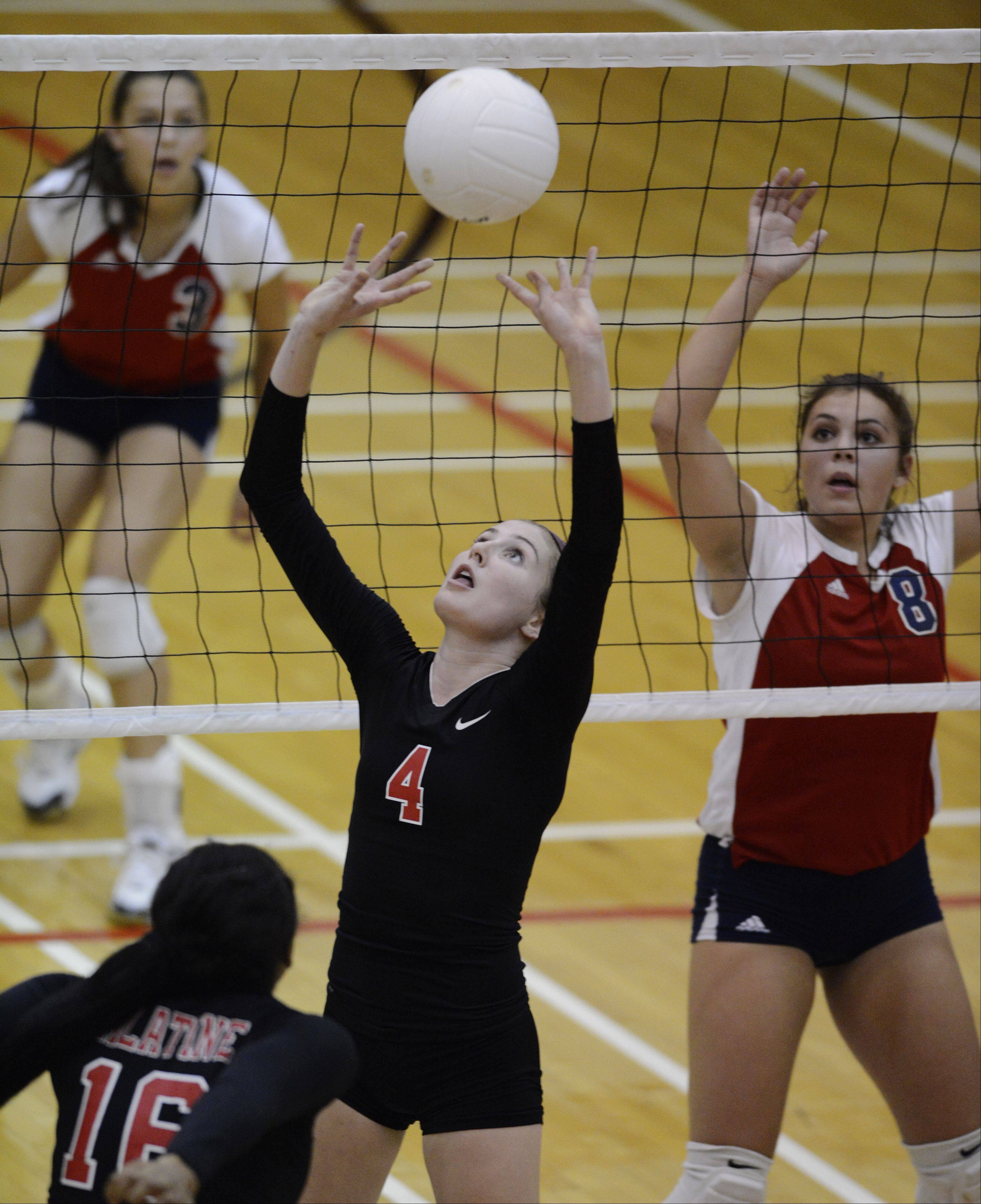 Palatine's Caitlin Riedy sets the ball as Conant's Drea Catalano stands ready at the net during Tuesday's match.