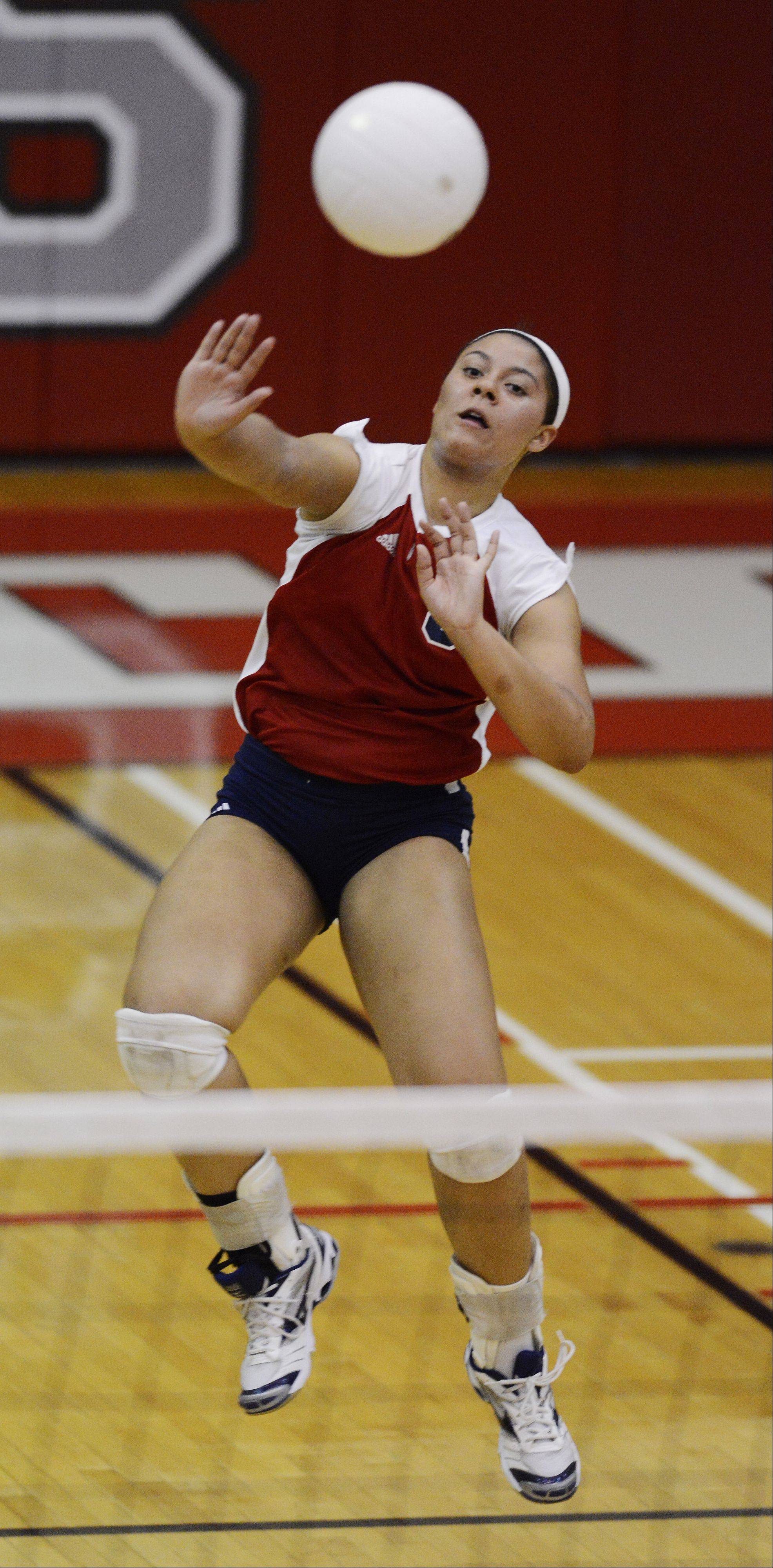 Conant's Jenn Donnell leaps on a kill attempt during Tuesday's match at Palatine.