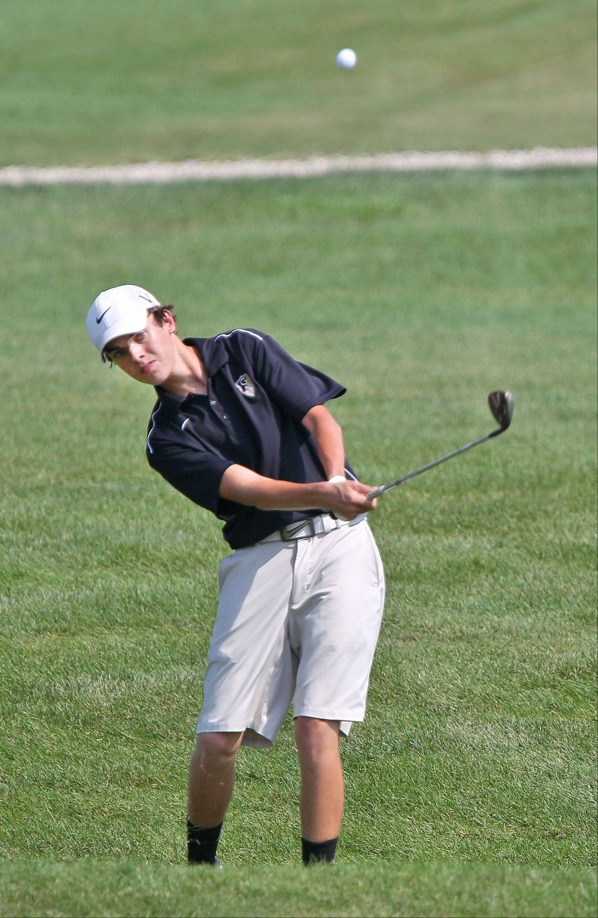 Grayslake North senior Kyle Sagendorph chips to green at No. 7 during Monday's Warren Open at the Merit Club in Libertyville.
