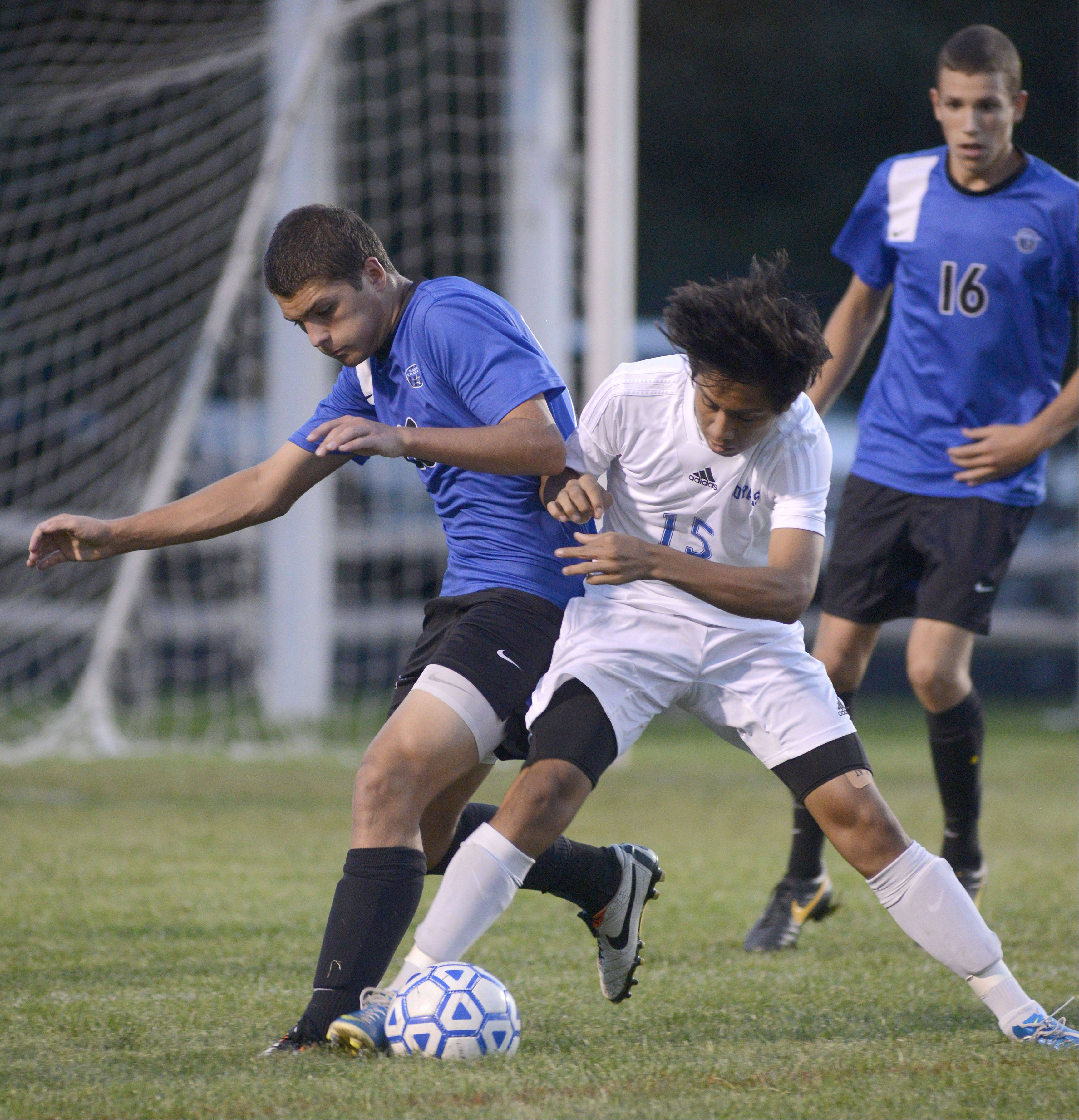 St. Charles North's Colin Kraft, left, and Larkin's Ricardo Nava battle for the ball in the first half on Tuesday at Memorial Field in Elgin.