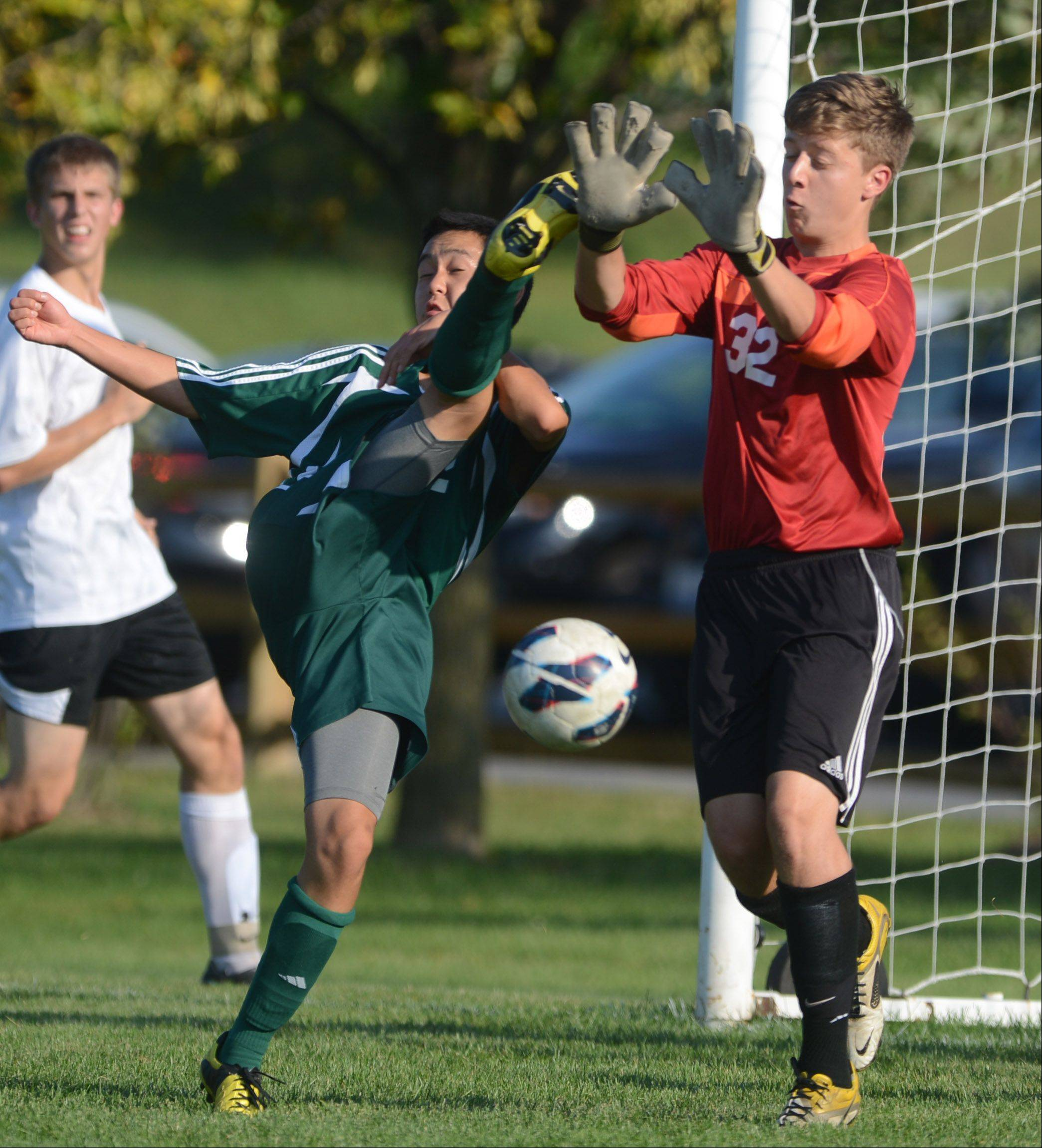 Libertyville goalkeeper Sam Muchmore, right, blocks a kick by Stevenson's Dean Lim during Tuesday's soccer game in Libertville.