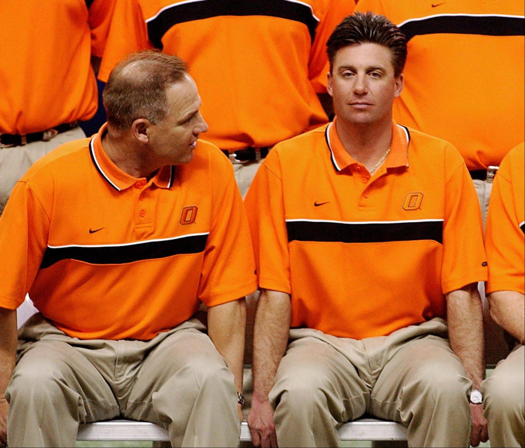 According to a Sports Illustrated report, players under former Oklahoma State head coach Les Miles, left, and current coach Mike Gundy accepted tens of thousands of dollars from boosters and staff members.
