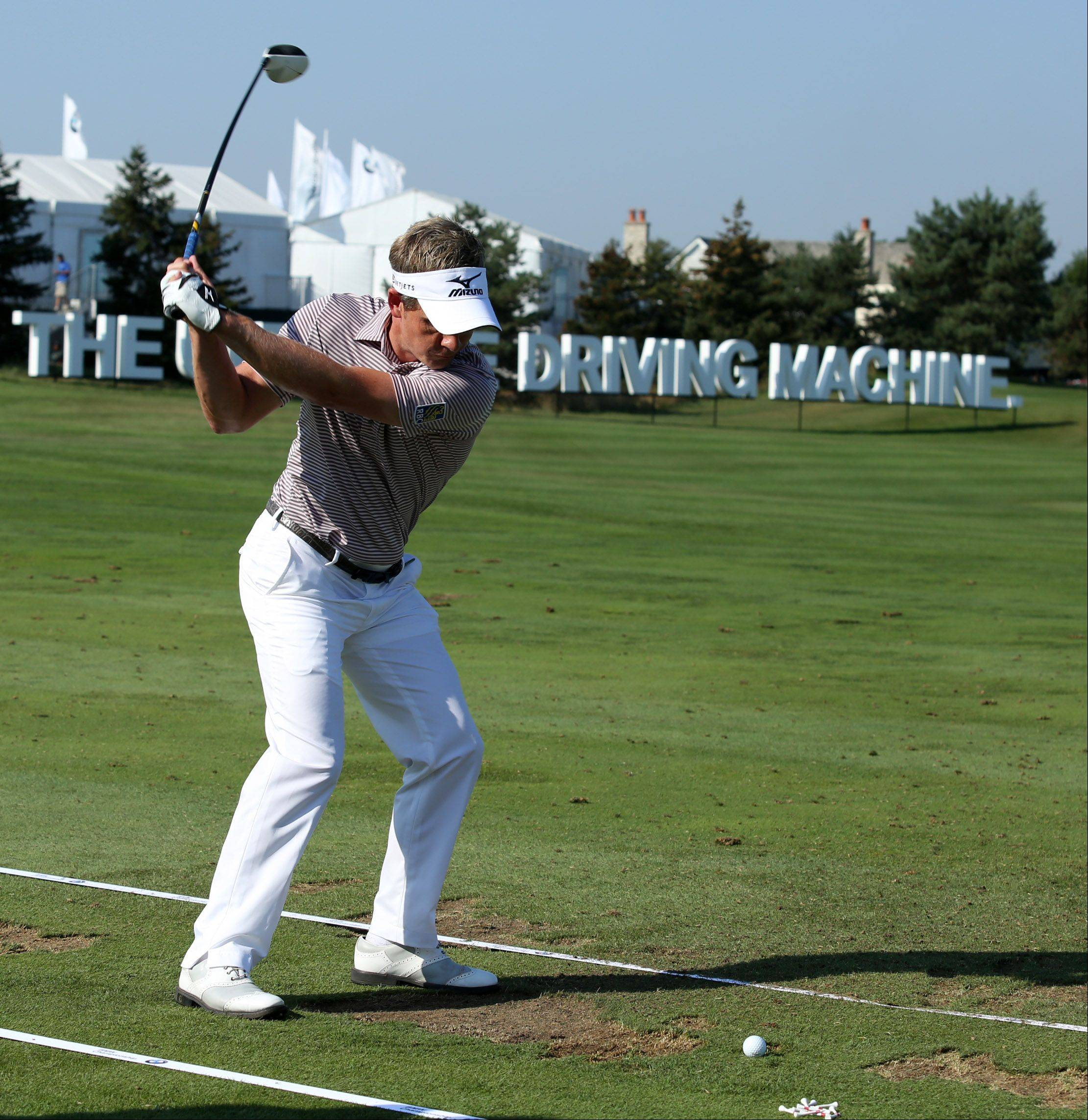 Luke Donald practices on the driving range Tuesday.