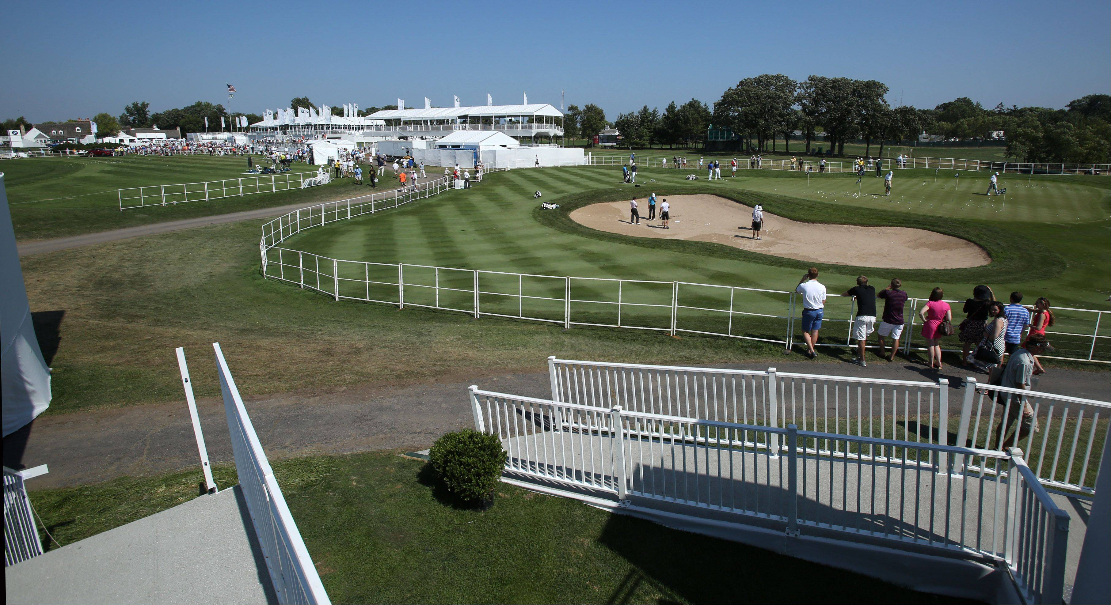 Competitors practice for the BMW Championship at Conway Farms Golf Club in Lake Forest on Tuesday