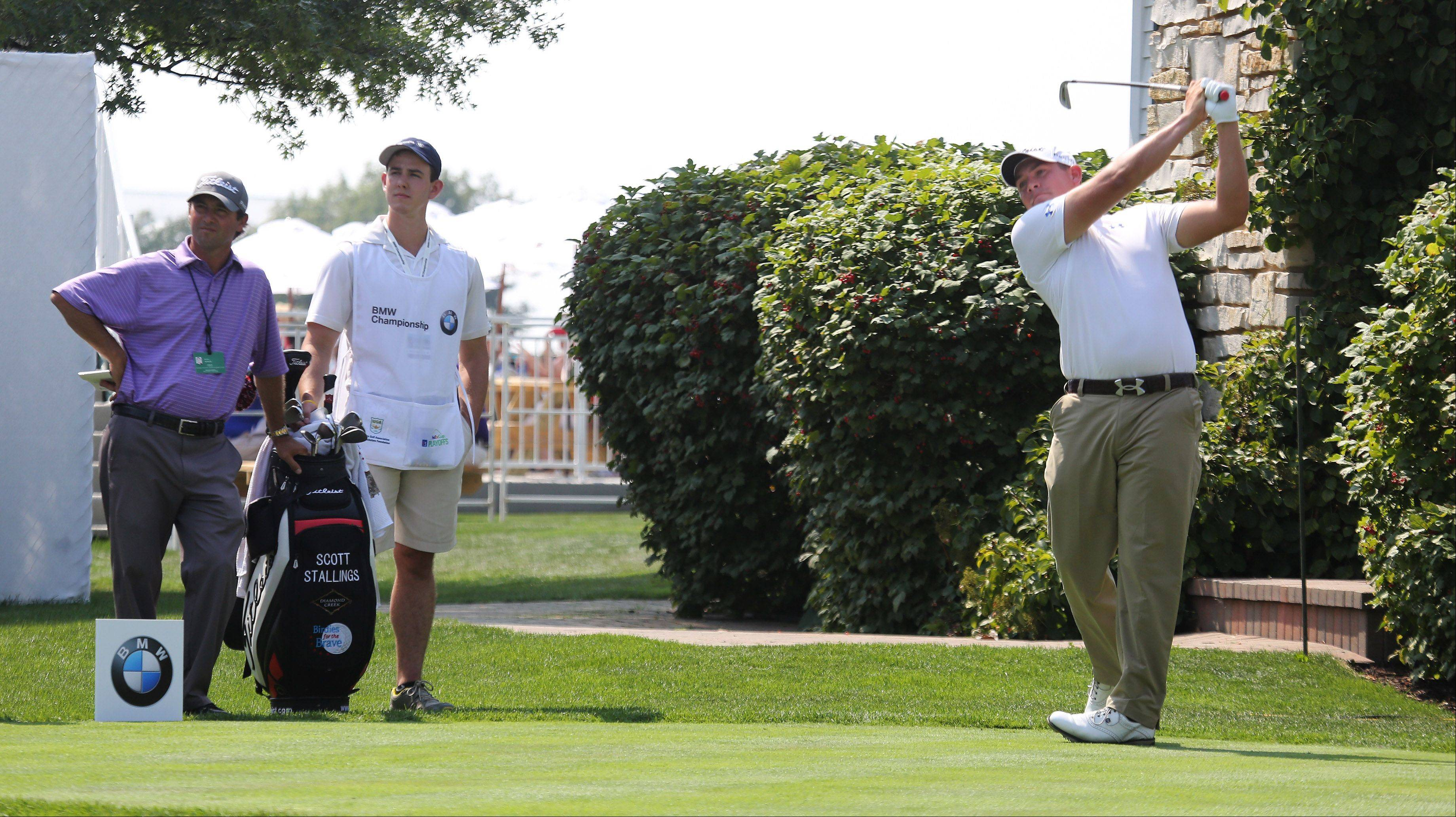 Professional golfer Scott Stallings tees off on the third hole Monday.