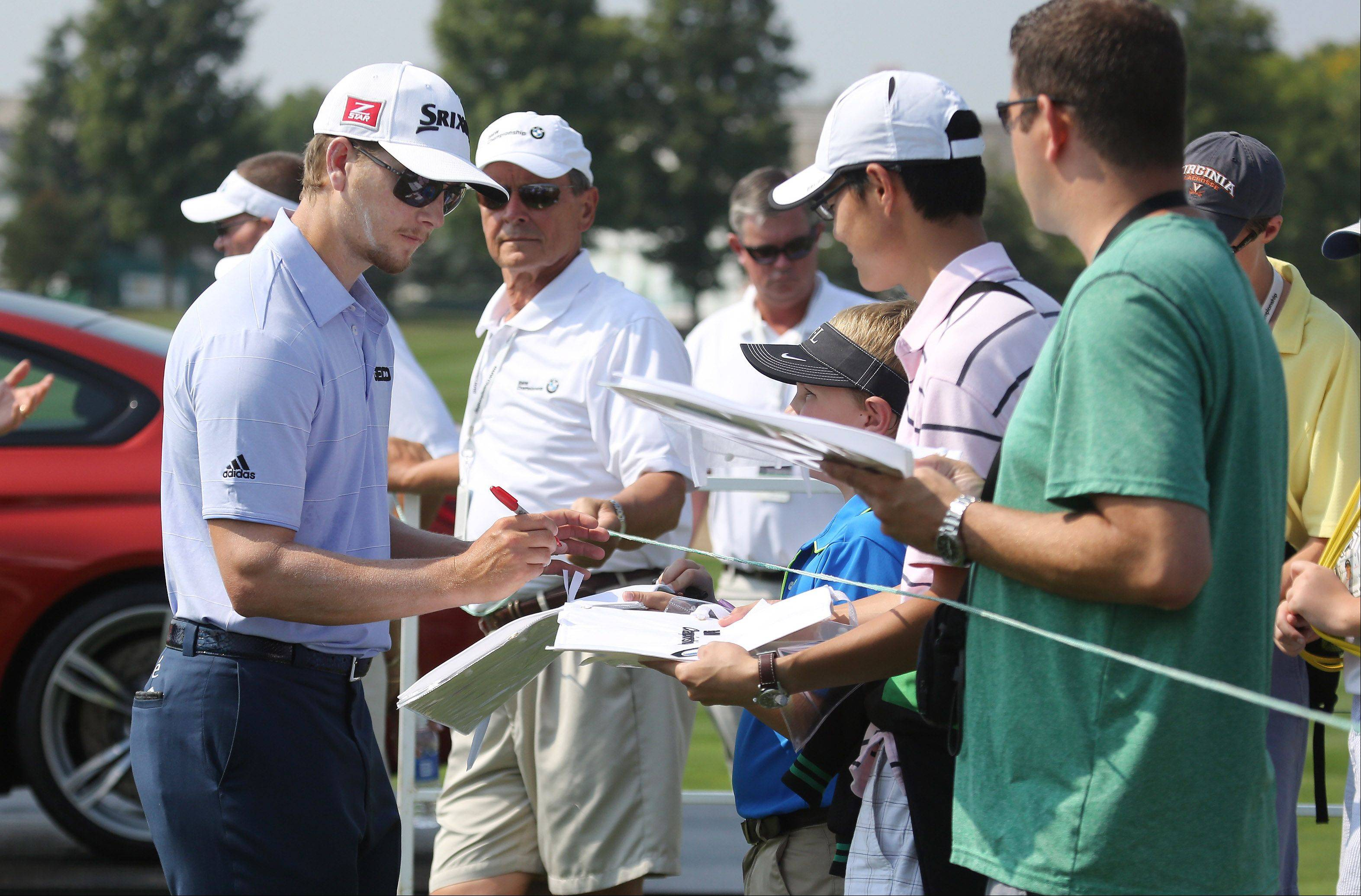 Professional golfer Chris Stroud signs autographs Monday.