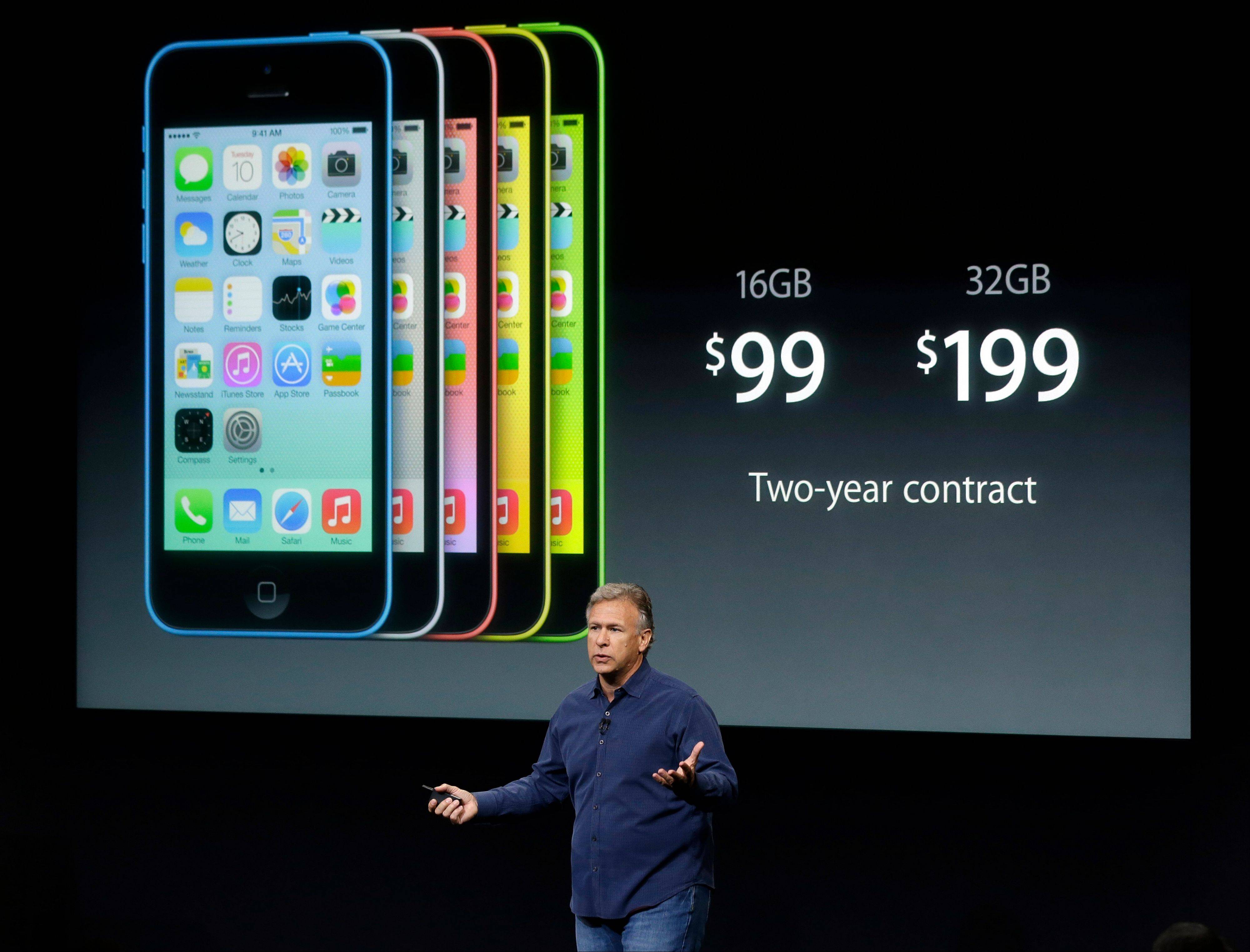 Phil Schiller, Apple's senior vice president of worldwide product marketing, discusses the new iPhone 5c in Cupertino, Calif., Tuesday. The new products Apple debuted Tuesday apparently did not impress investors on Wednesday.
