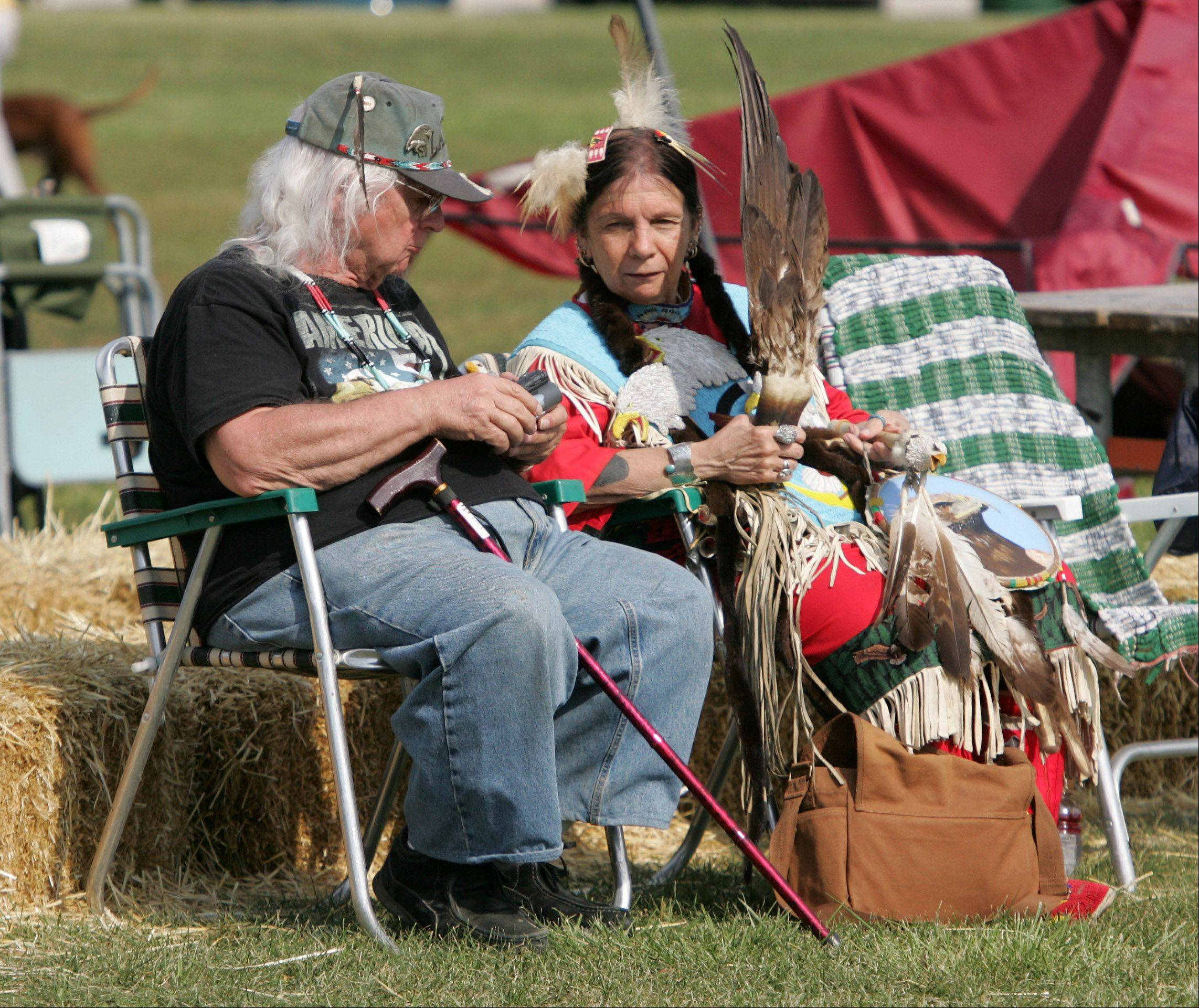 Lakota Indians Ronald and Barb Wolfbear, of Glen Ellyn, wait for the start of the Grand Entrance during the 59th Annual American Indian Center Pow Wow at Busse Woods Forest Preserve in Elk Grove Village. The event features Native American dance competition, singers, artists, food vendors, storytelling and archery.