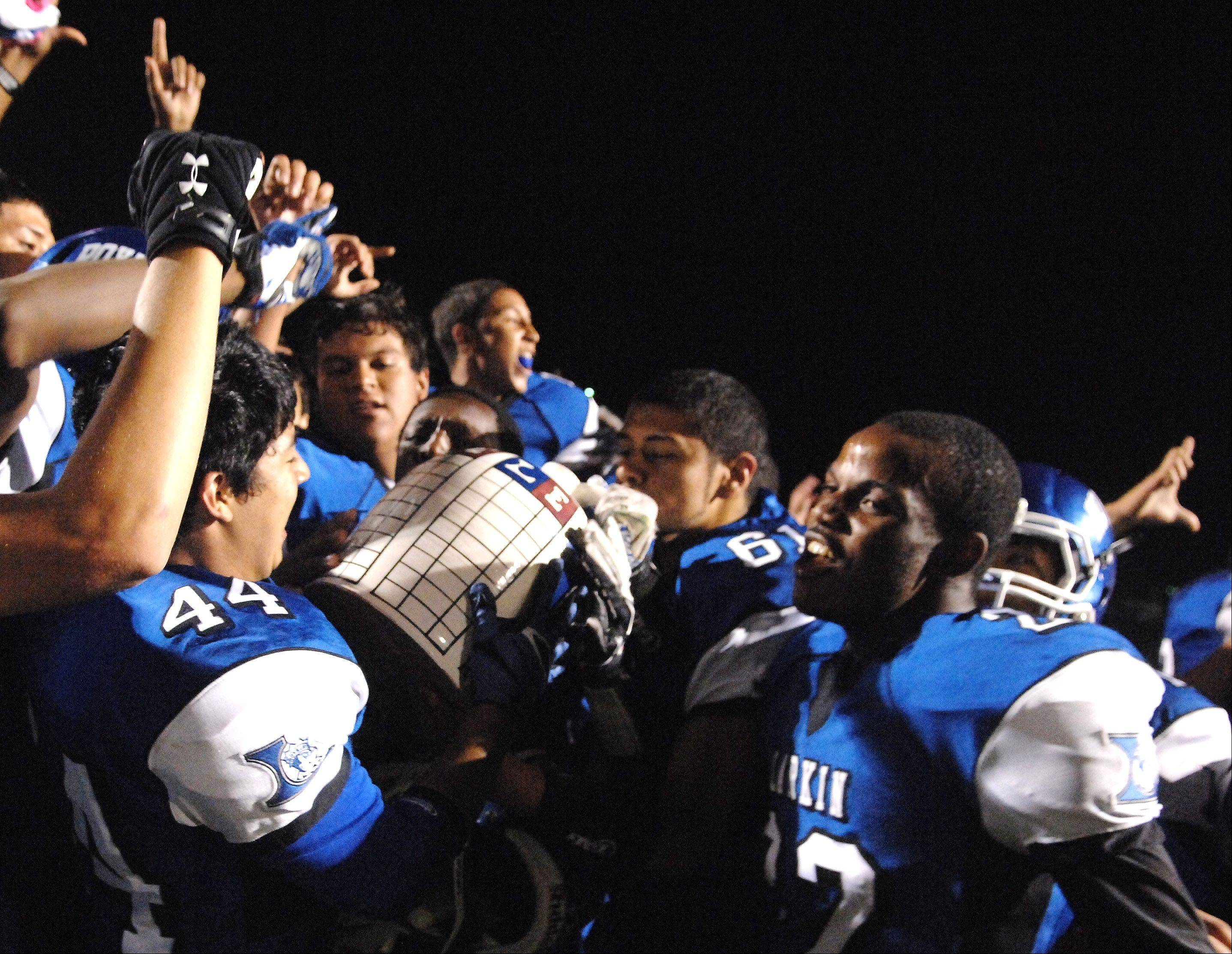 Larkin players celebrate with the Town Jug following their win over Elgin last year. The Royals will look to keep the Jug on the west side for the third straight year when the Royals and Maroons battle at Memorial Field Friday night.