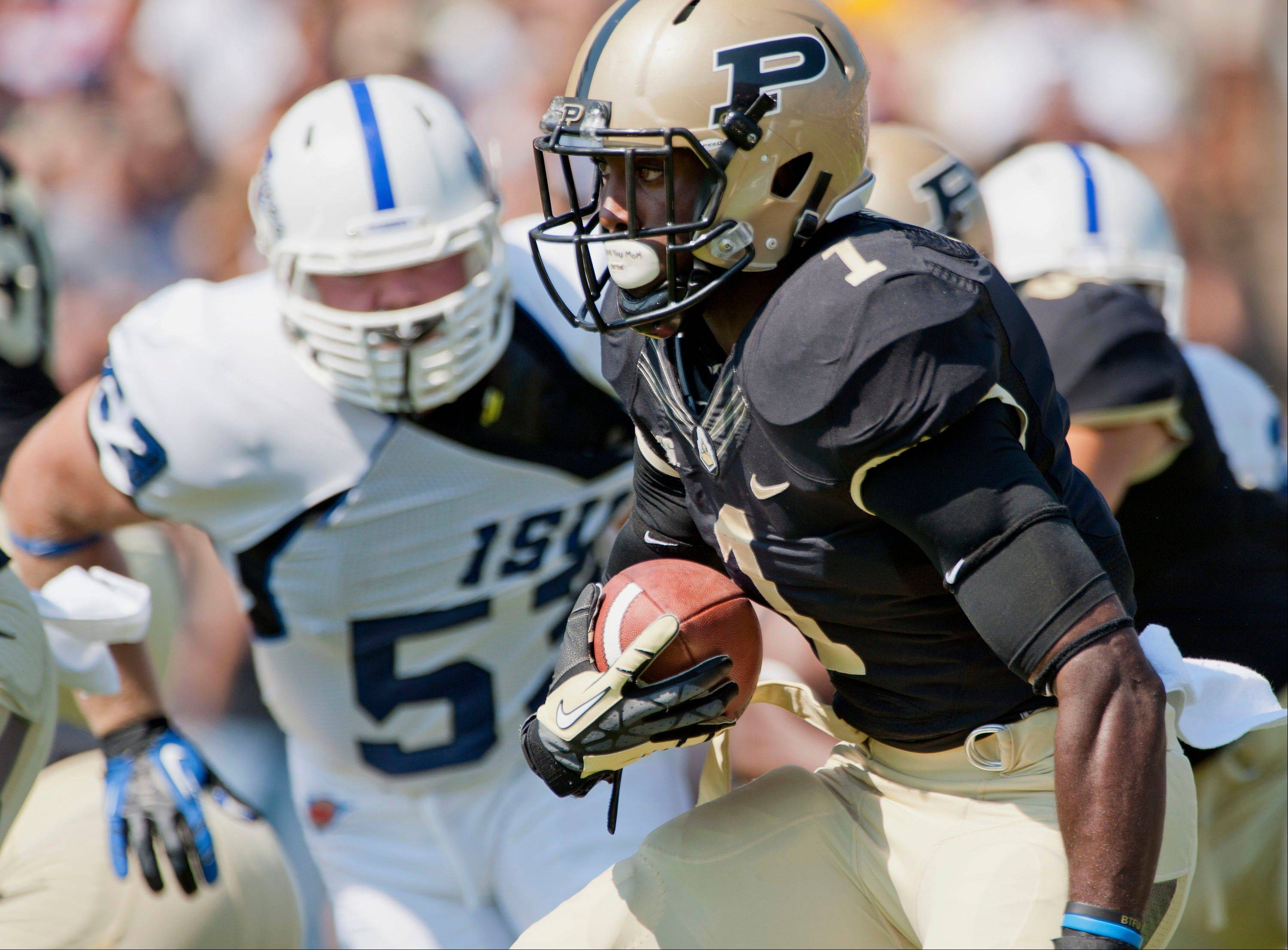 Purdue�s Akeem Hunt carries the ball against Indiana State during the first half of last Saturday�s win in West Lafayette, Ind. The Boilermakers have scored only two offensive touchdowns so far this season.