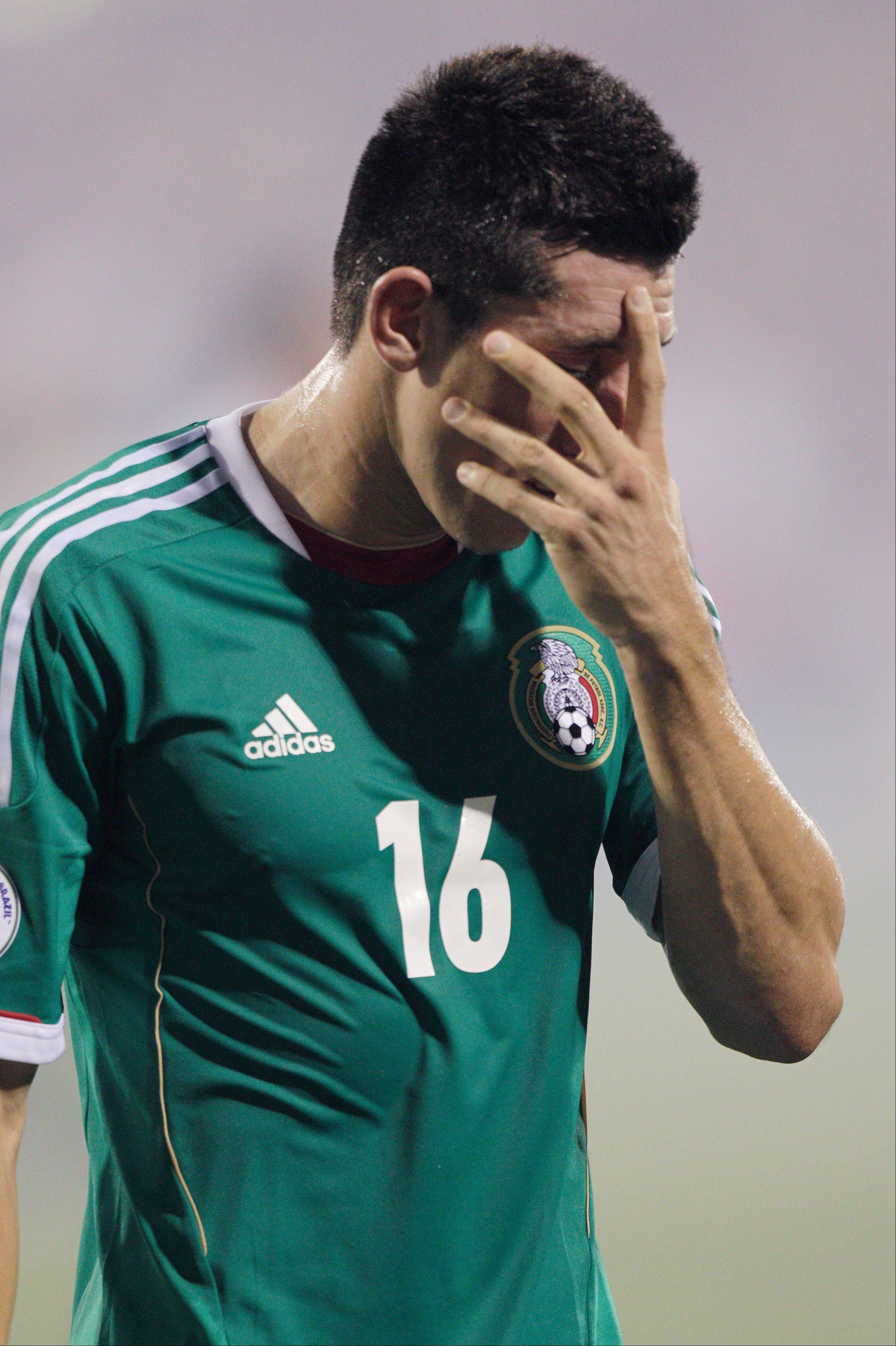 Mexico's Hector Herrera walks off the field after the team's 2-0 loss to the United States in a World Cup qualifier Tuesday.