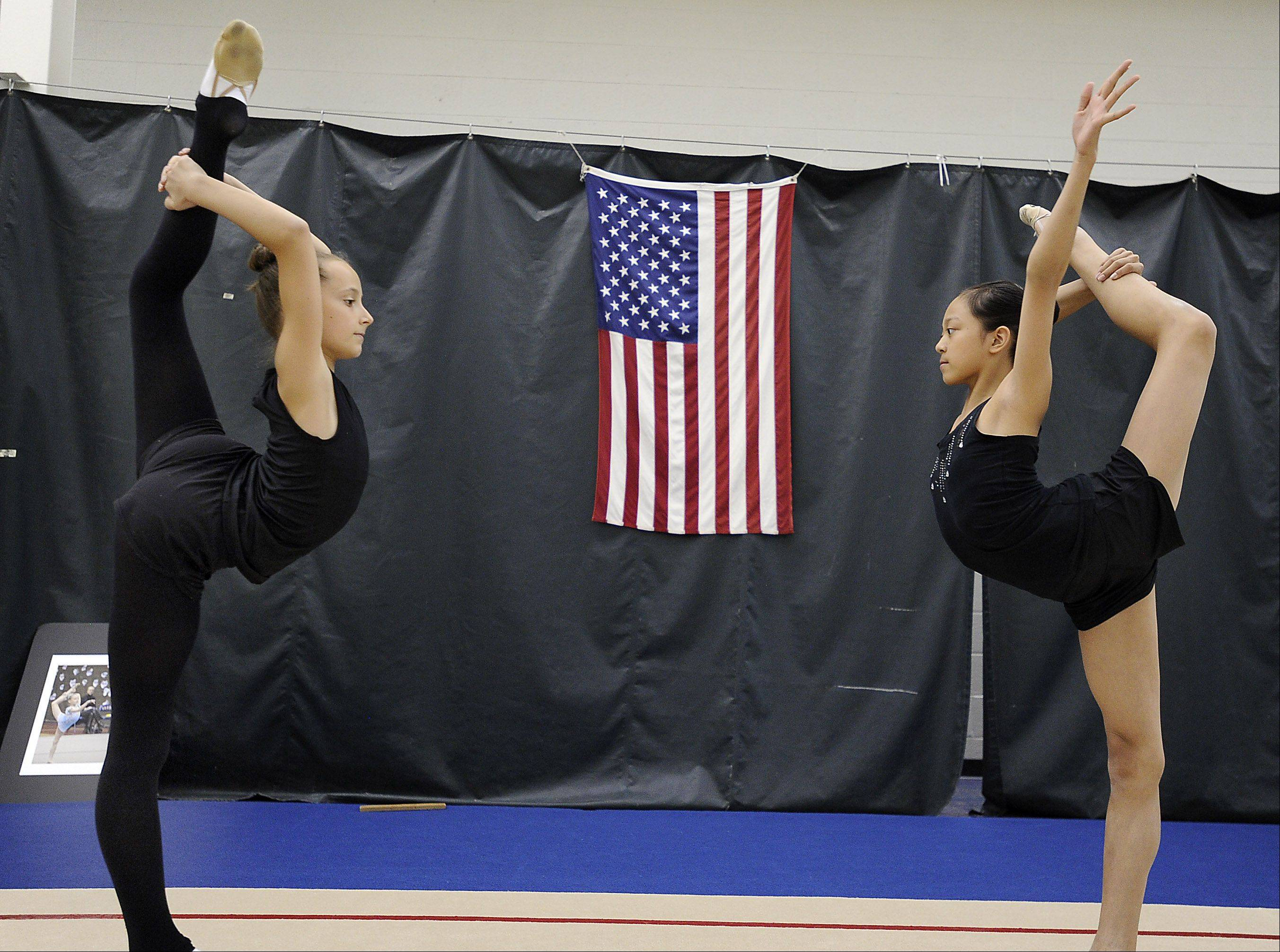 Camilla Feeley, 13, left, of Lincolnshire and Laura Zeng, 13, of Libertyville warm up for a recent training session at the North Shore Rhythmic Gymnastic Center in Deerfield. Both are members of the junior national team and Laura is the reigning national junior champion.